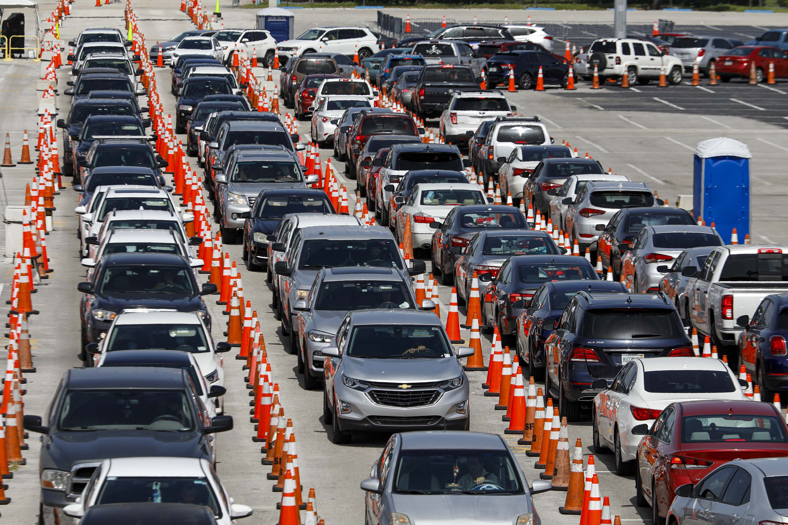People in their vehicles wait to enter a Covid-19 drive-thru testing site at Hard Rock Stadium in Miami Gardens, Florida, on June 30.