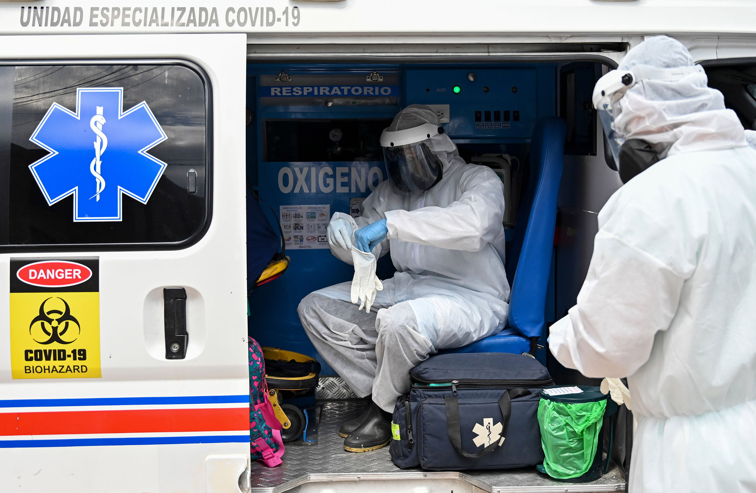 Health workers move a recovered novel coronavirus patient from the Versalles clinic to her home on June 24, 2020, in Cali, Colombia.
