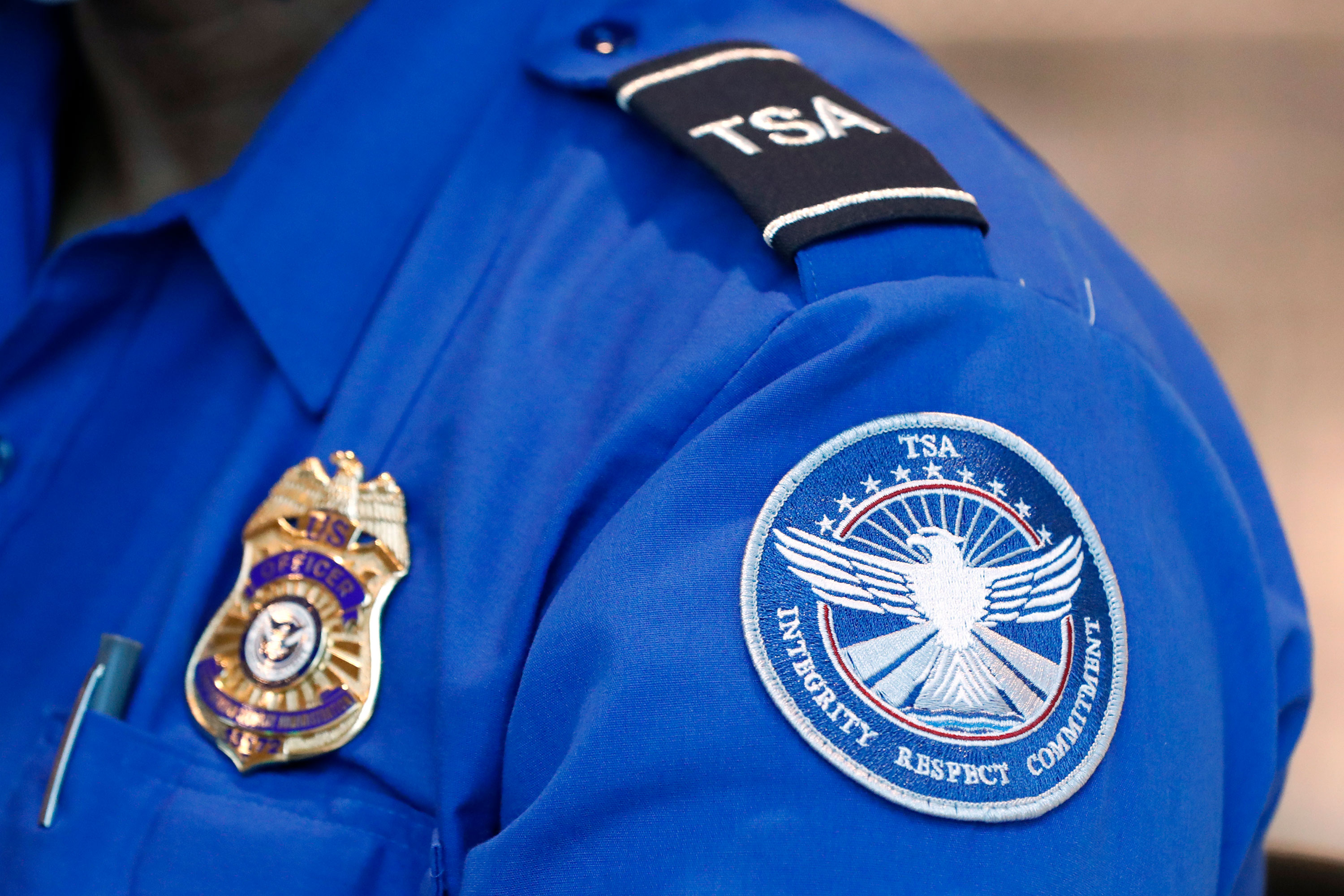 A TSA agent assists travelers at Love Field airport in Dallas, Texas, on June 24.