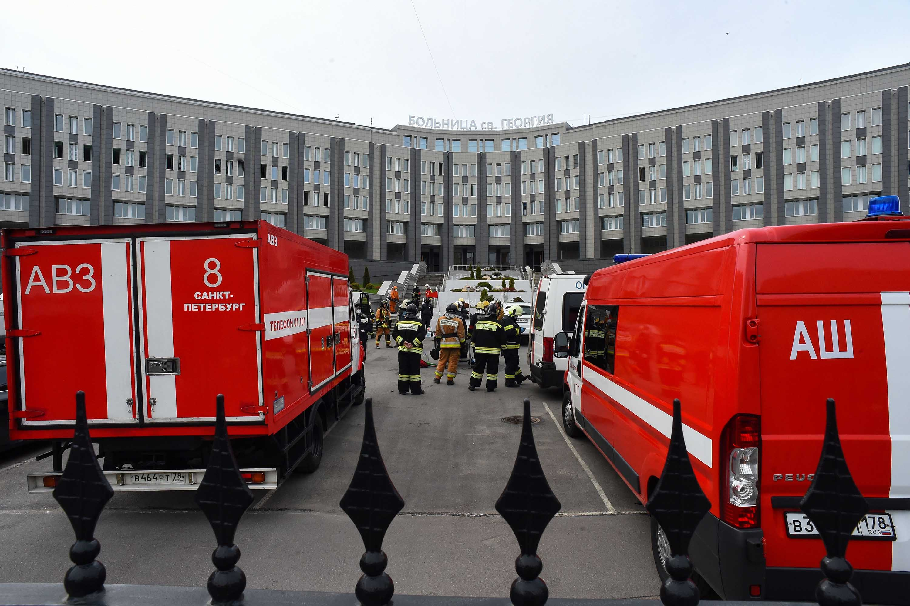 Emergency personnel work at the site of a fire at the St. George Hospital in St. Petersburg on May 12.