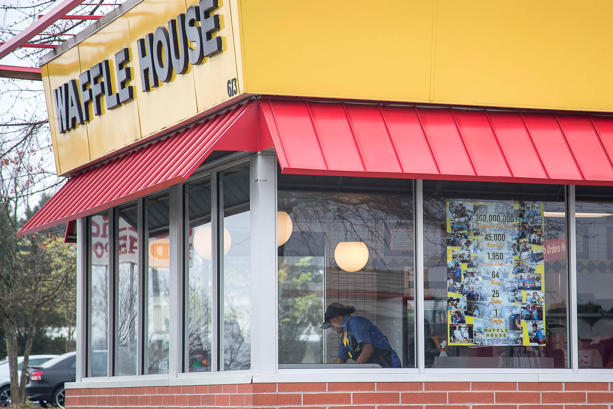 A Waffle House employee can be seen cleaning tables at this Lithia Springs location, Thursday, March, 19.