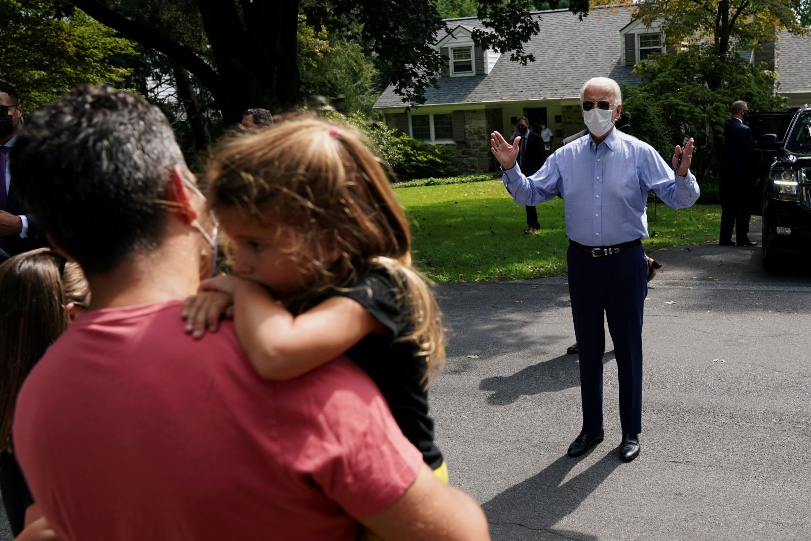 Biden speaks with supporters from a distance after he met with labor leaders in Lancaster, Pennsylvania, on September 7.