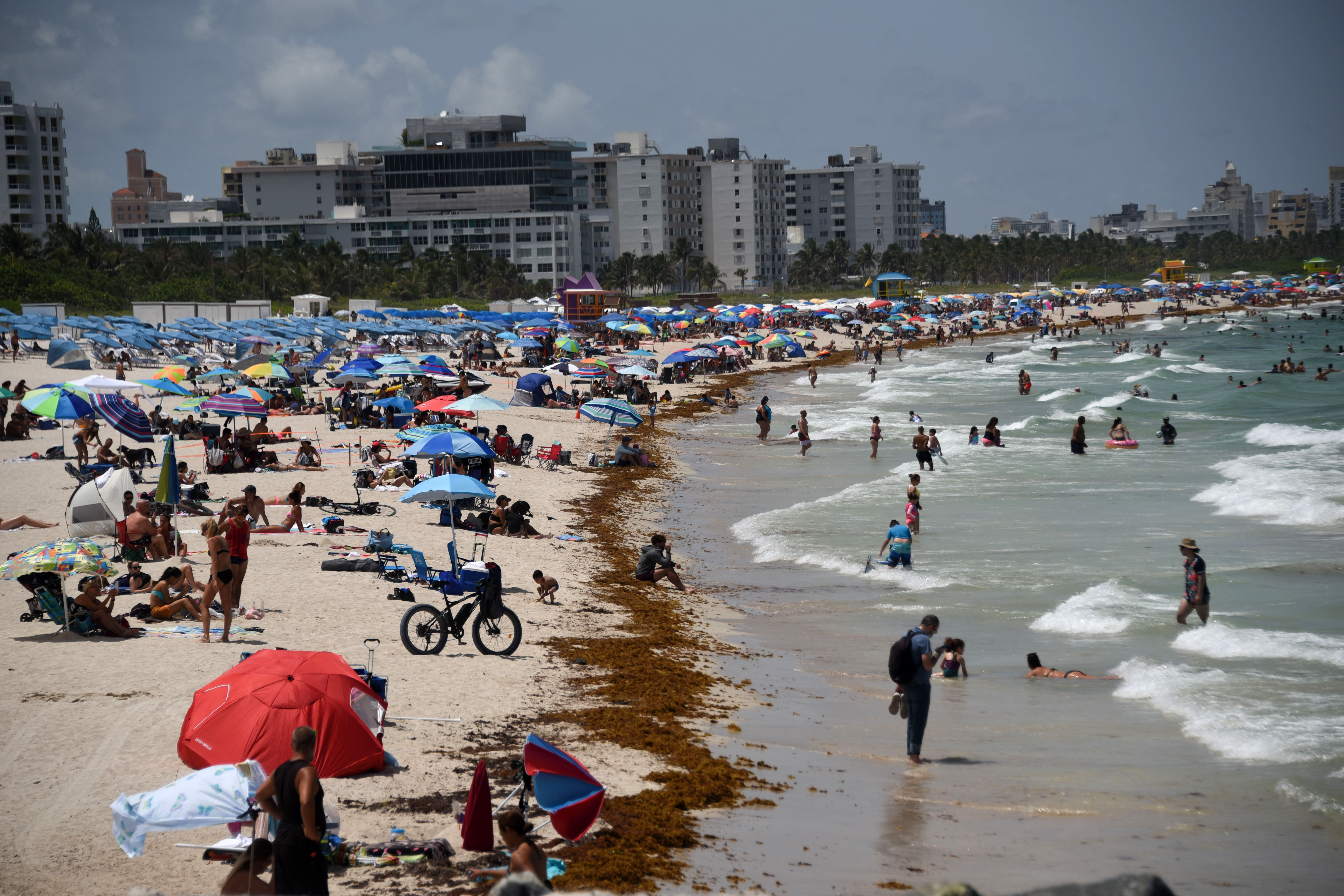 People visit South Beach in Florida on June 27.