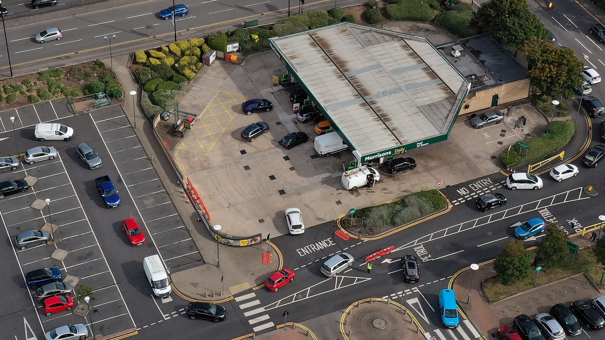 Motorists wait in line at a gas station in Coventry, England, on Tuesday.
