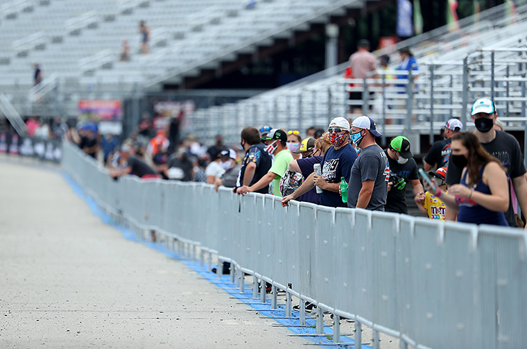 Fans wear masks and face coverings look on prior to the NASCAR Cup Series Foxwoods Resort Casino 301 at New Hampshire Motor Speedway on August 02, 2020 in Loudon, New Hampshire.