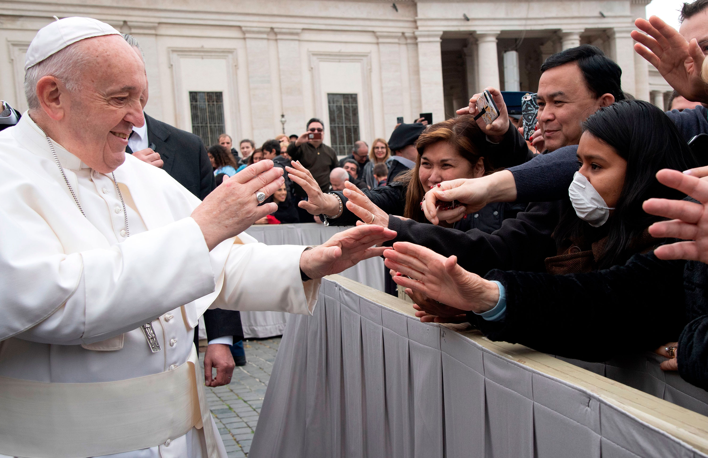 Pope Francis greets people at St. Peter's Square in the Vatican at the end of his weekly general audience on Wednesday, February 26.