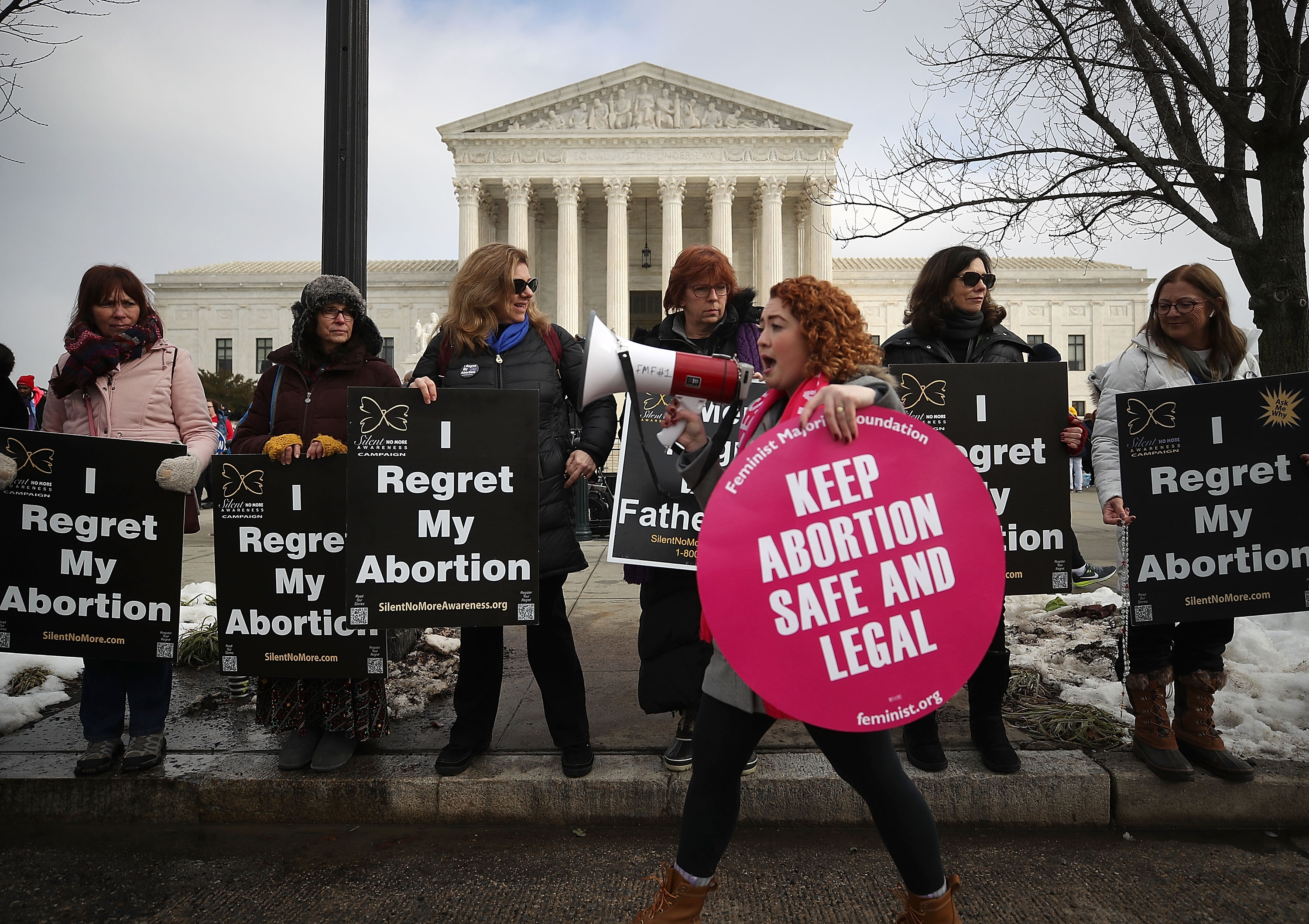 Protesters on both sides of the abortion issue gather in front of the U.S. Supreme Court on January 18.