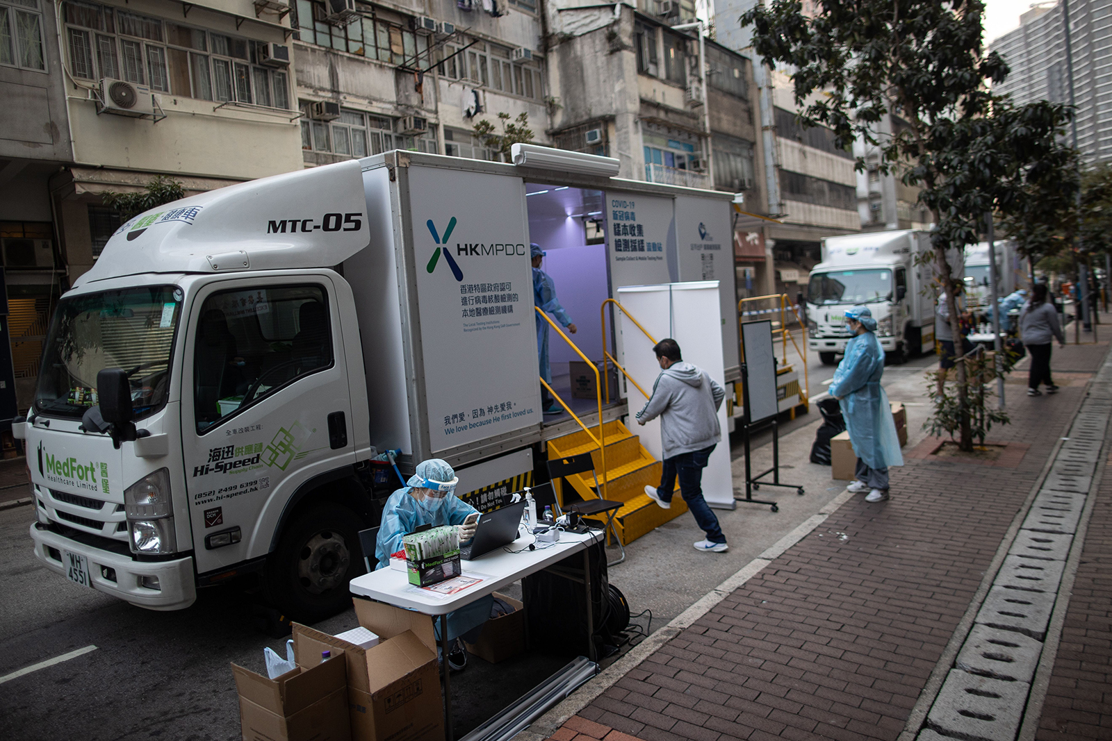 A man enters a mobile testing station to undergo a coronavirus test in Hong Kong, on January 17.
