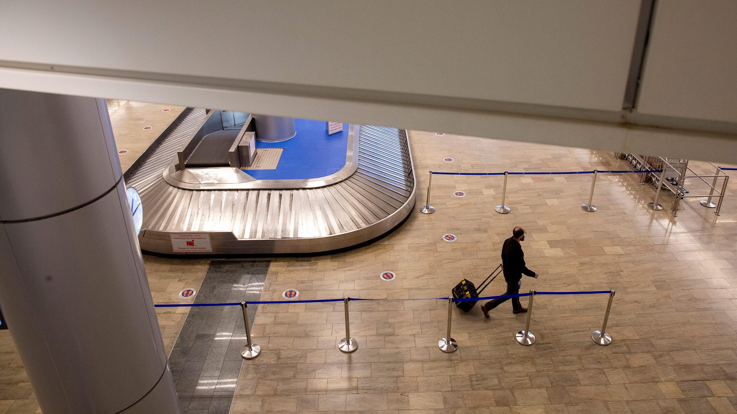 A passenger walks through the arrival hall of Ben Gurion Airport near Tel Aviv, Israel, on Sunday, January 24.