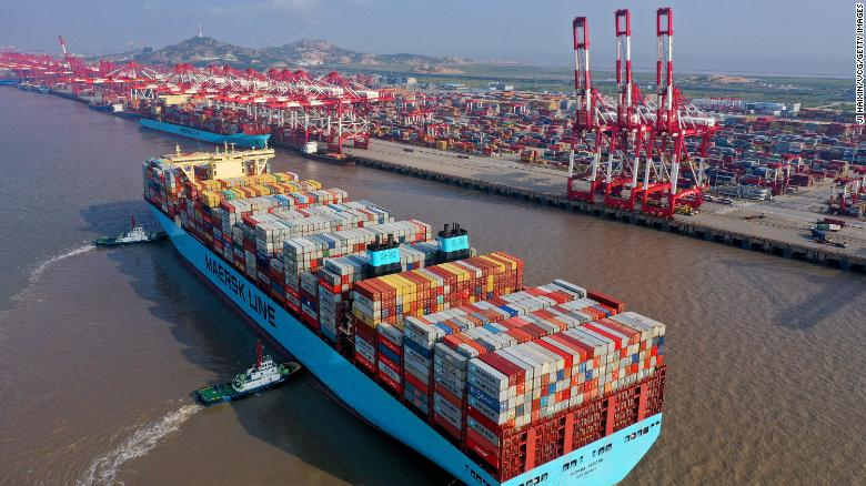 Tugboats guide a container ship at the Yangshan Deepwater Port, Shanghai.