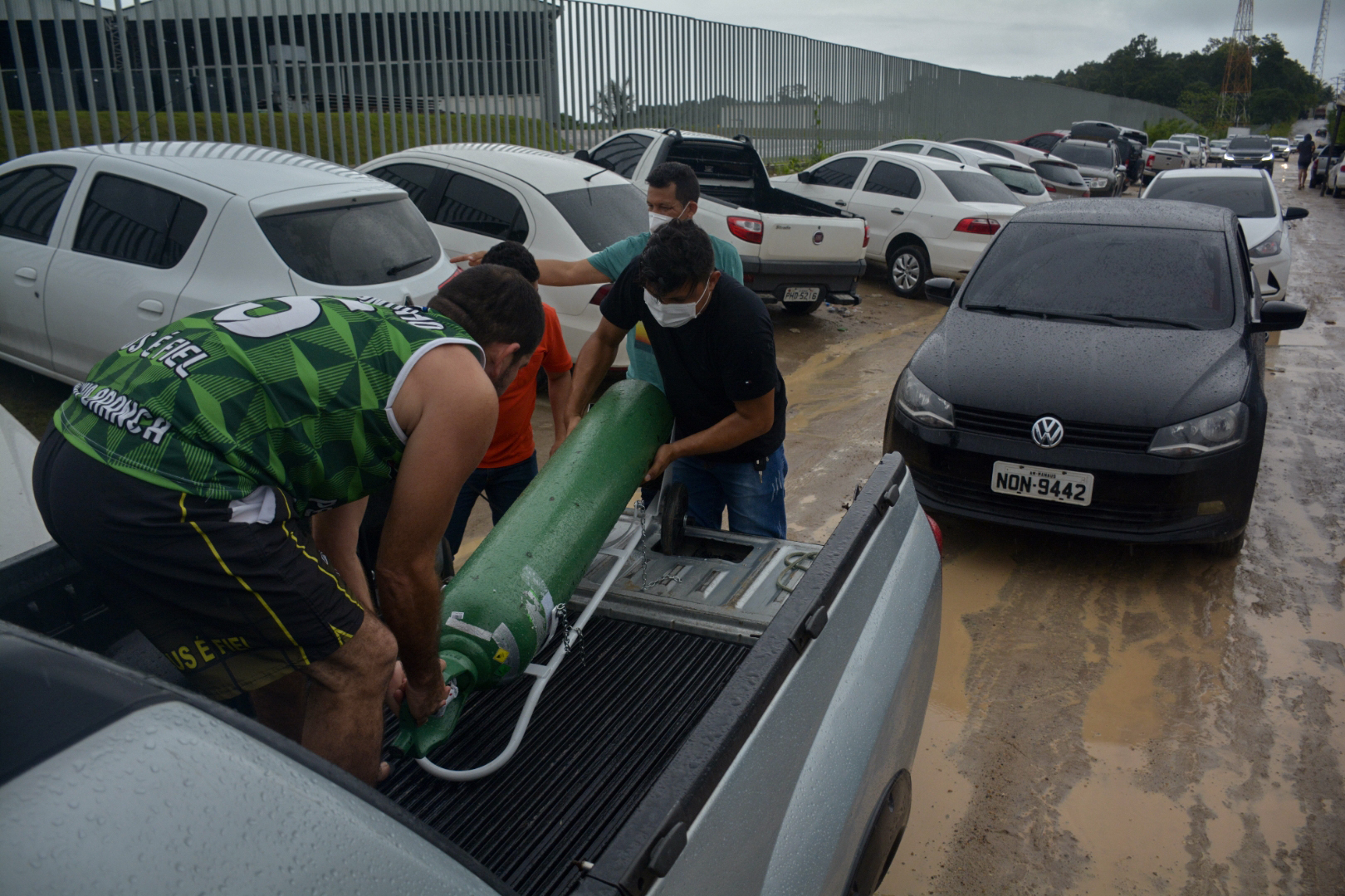 Relatives of patients infected with Covid-19 leave after queueing for long hours to refill their oxygen tanks at the Carboxi company in Manaus, Amazonas state, Brazil, on Tuesday.