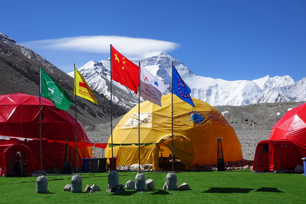 Flags fly at base camp on the north slope of Mount Everest on May 9, 2021 in Shigatse, Tibet Autonomous Region of China.