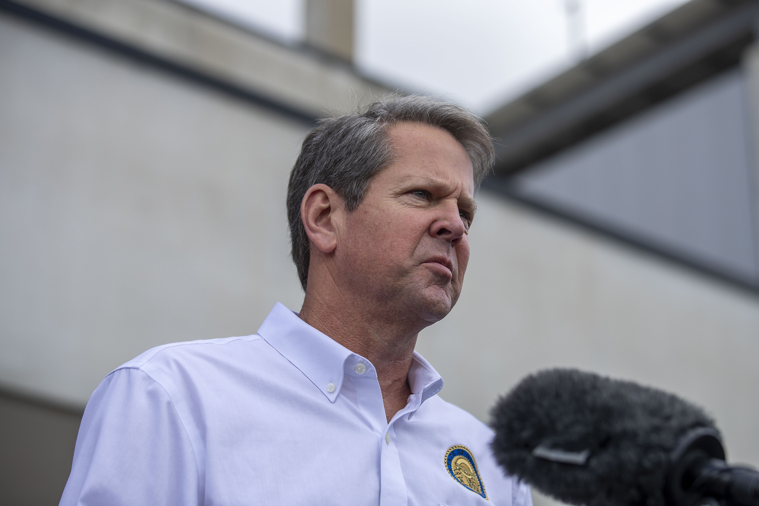 Governor Brian Kemp makes a statement and answers questions from the media following a tour of Fieldale Farms while visiting Gainesville, on Friday, May 15.