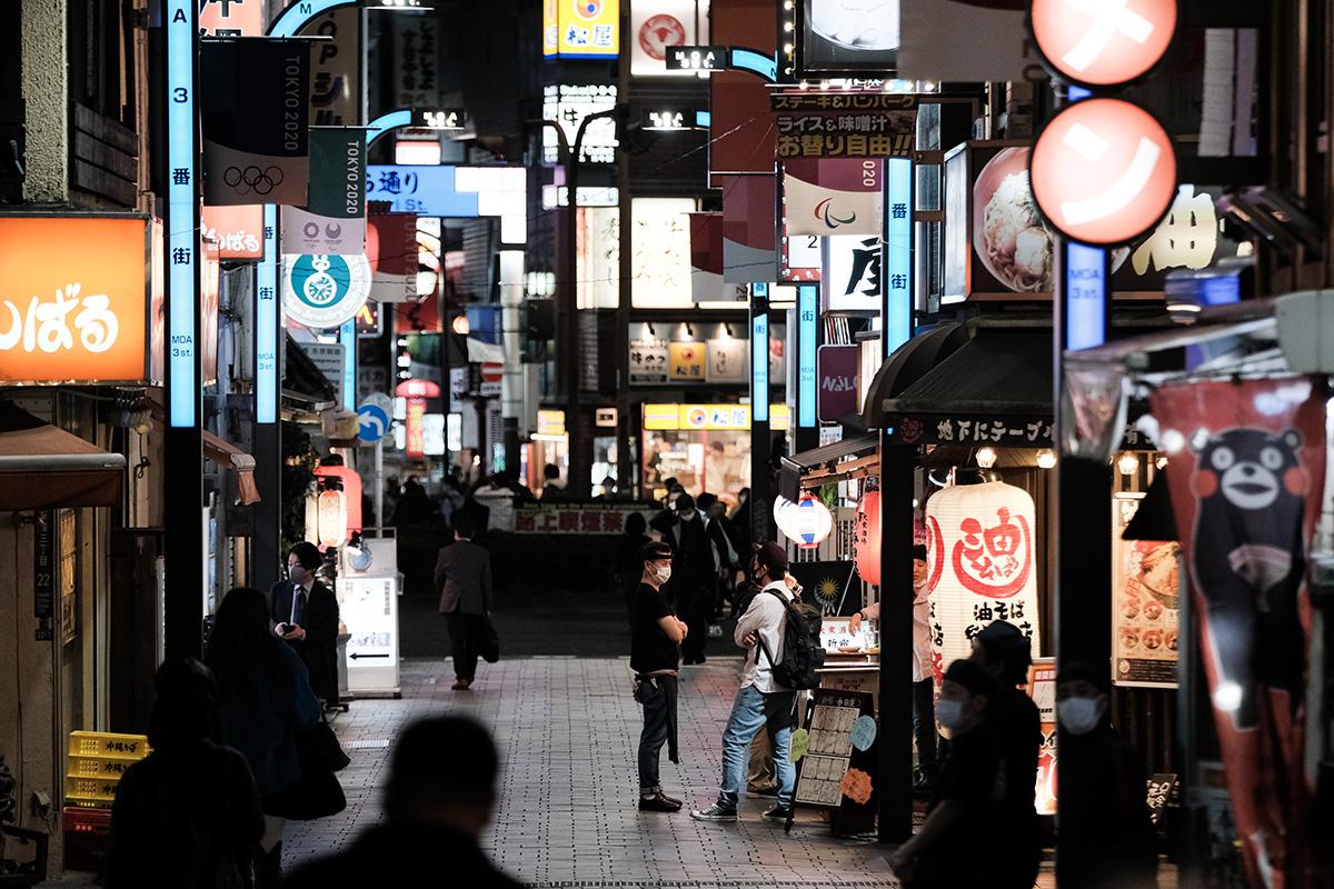 Pedestrians walk past restaurants at night in the Shinjuku district of Tokyo, Japan, on Thursday, Nov. 19.