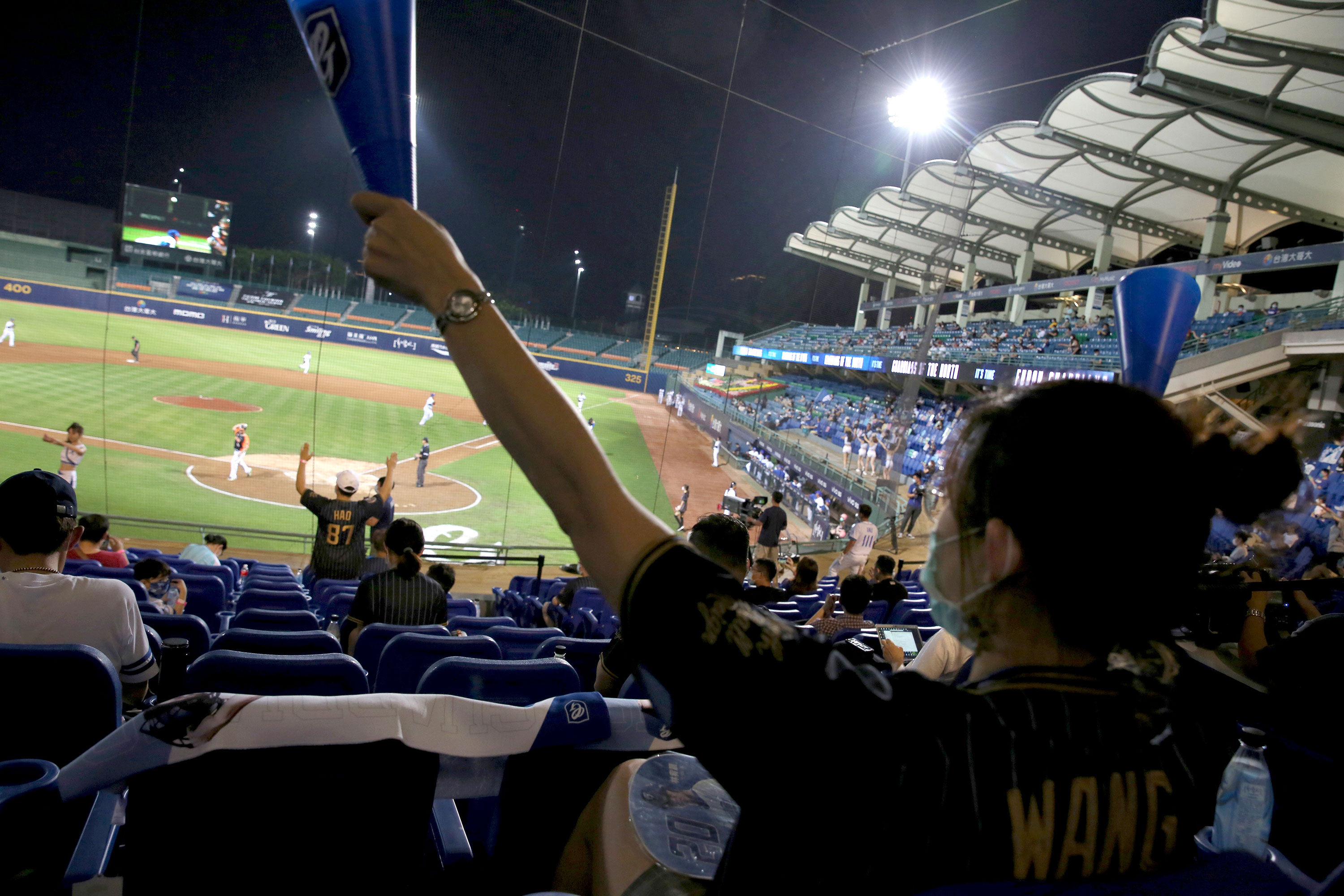 Fans cheer during the game between Fubon Guardians and Uni-President Lions at Xinzhuang Baseball Stadium in New Taipei City on May 8.