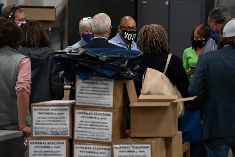 A Fulton County Board of Elections official, center, speaks to lawyers and representatives for the Democratic and Republican parties at the Fulton County Registration and Election warehouse in Atlanta, Georgia, on Wednesday, November4.