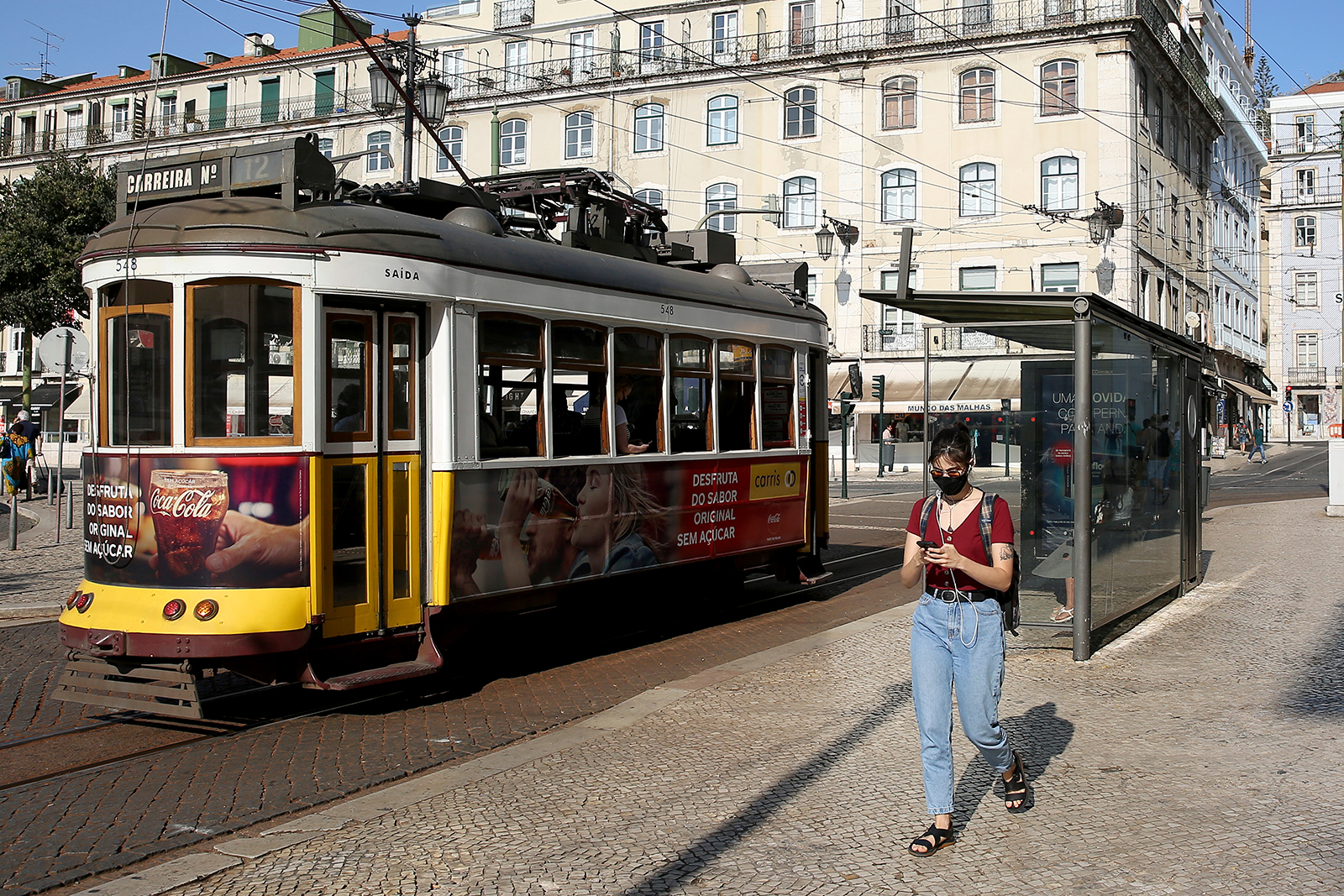 A woman walks in downtown Lisbon, Portugal, on Tuesday, September 15.
