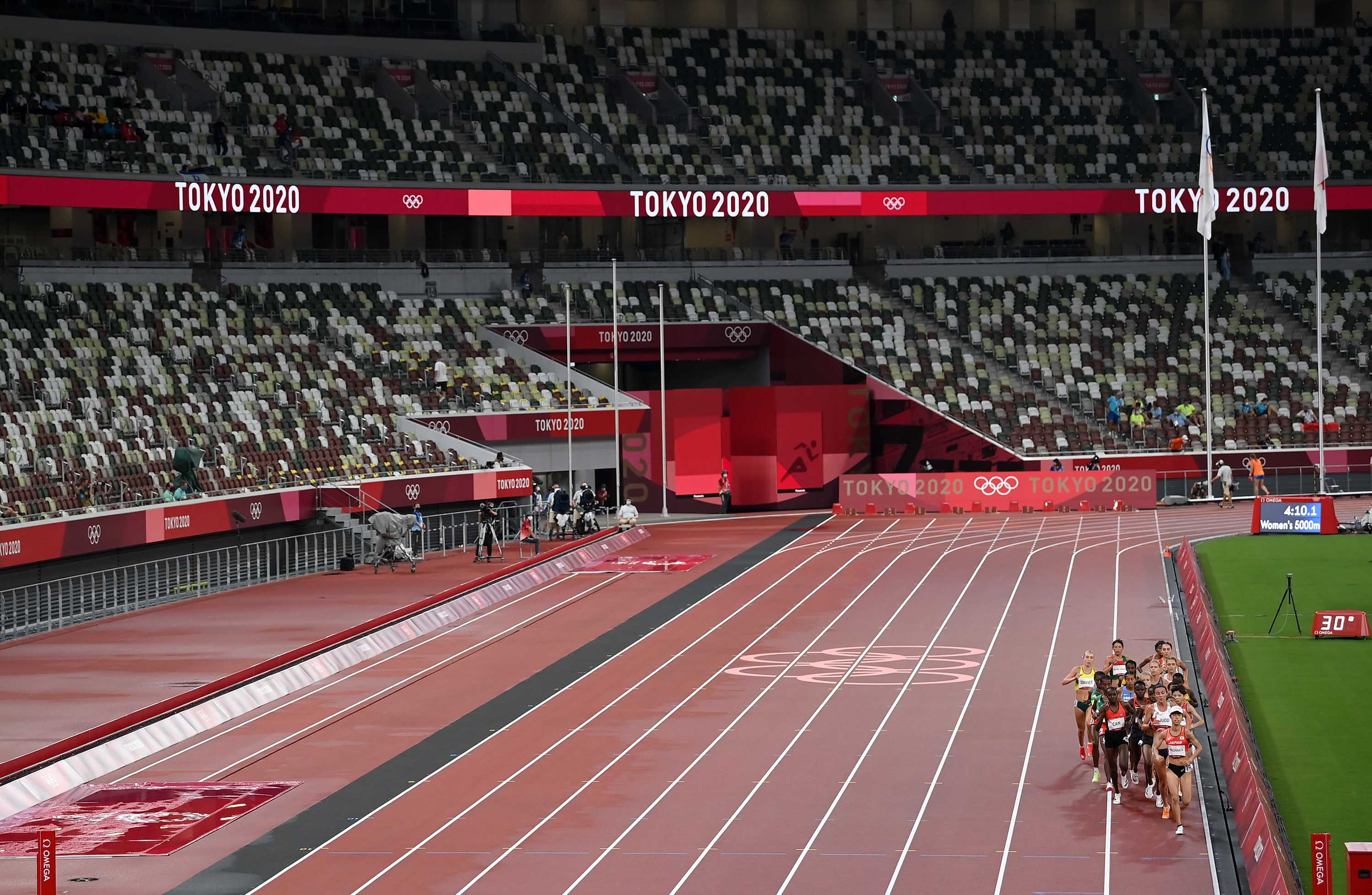 A general view shows empty stands during the first of the women's 5,000m heats at the Olympic Stadium in Tokyo on Friday.