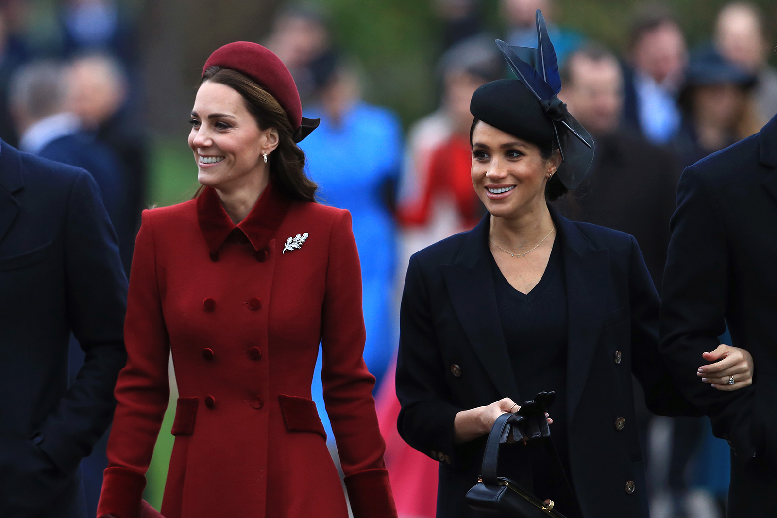 Catherine, Duchess of Cambridge and Meghan, Duchess of Sussex arrive to attend Christmas Day Church service at Church of St Mary Magdalene on the Sandringham estate on December 25, 2018 in King's Lynn, England.