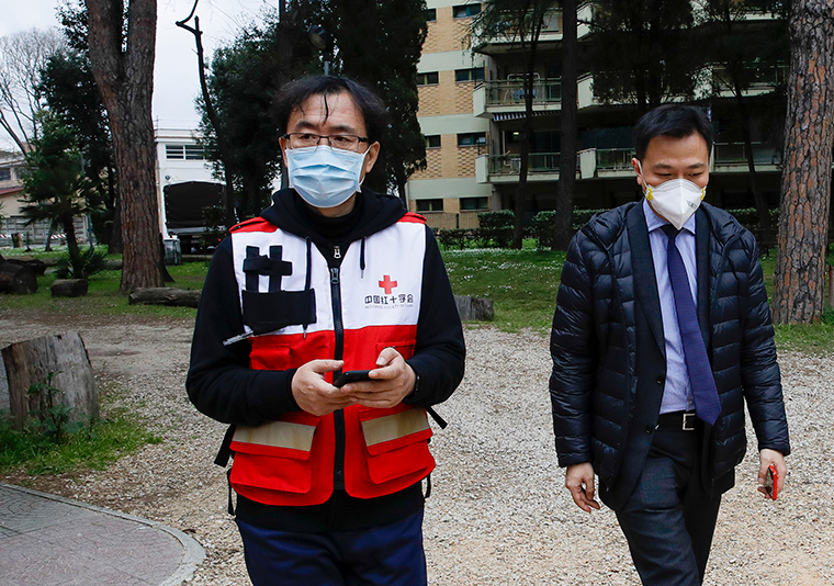 Sun Shuopeng, left, Vice President of China's Red Cross leaves the Red Cross headquarters in Rome after a press conference on Friday, March 13.