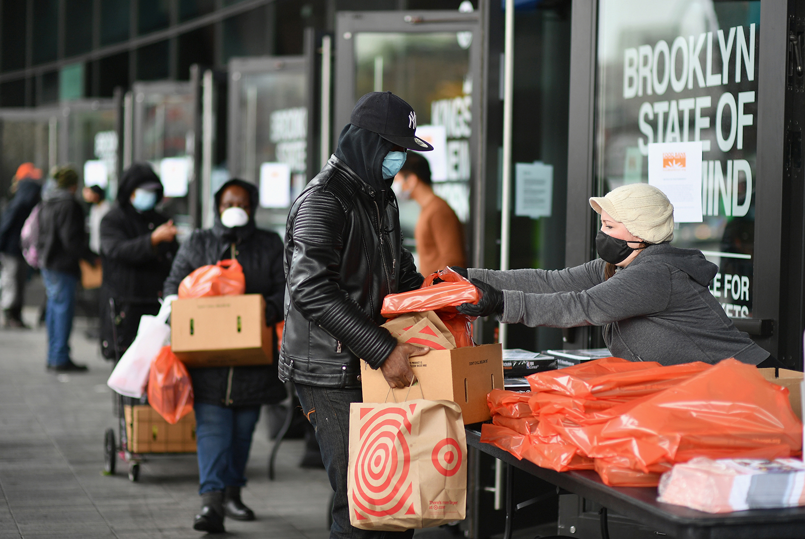 People wait in line at a food bank on the Barclays Center plaza in Brooklyn, New York, on April 24.