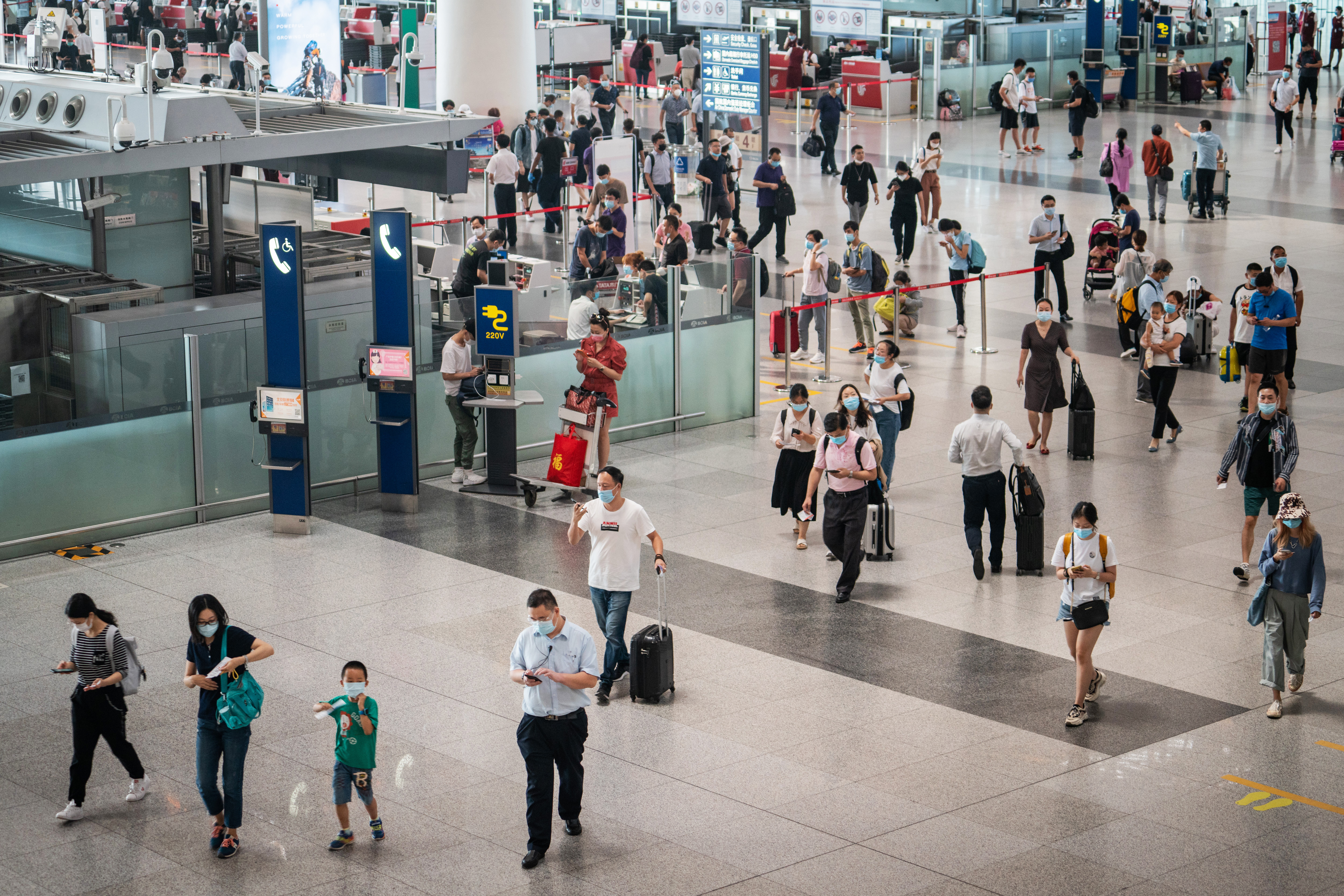People walk through Beijing Capital International Airport in China, on August 25.