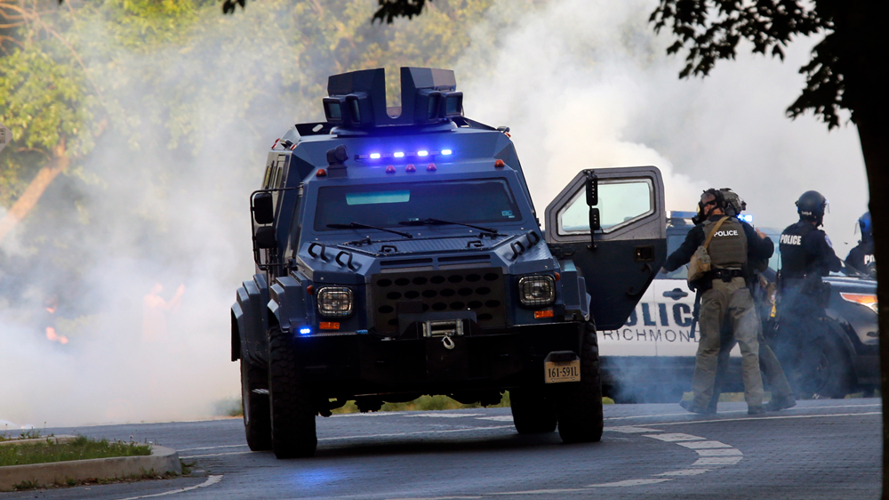 A State Police tactical vehicle is surrounded by a cloud of tear gas at the Lee Monument on Monument Avenue in Richmond, Virginia, on Monday, June 1.