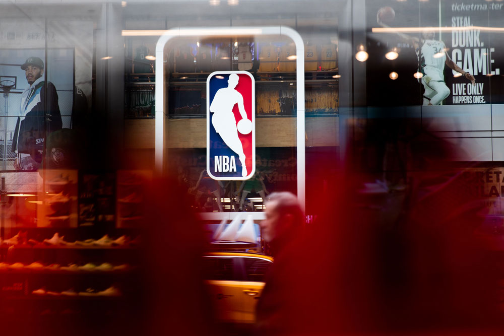 An NBA logo is shown at the 5th Avenue NBA store on March 12, in New York City.