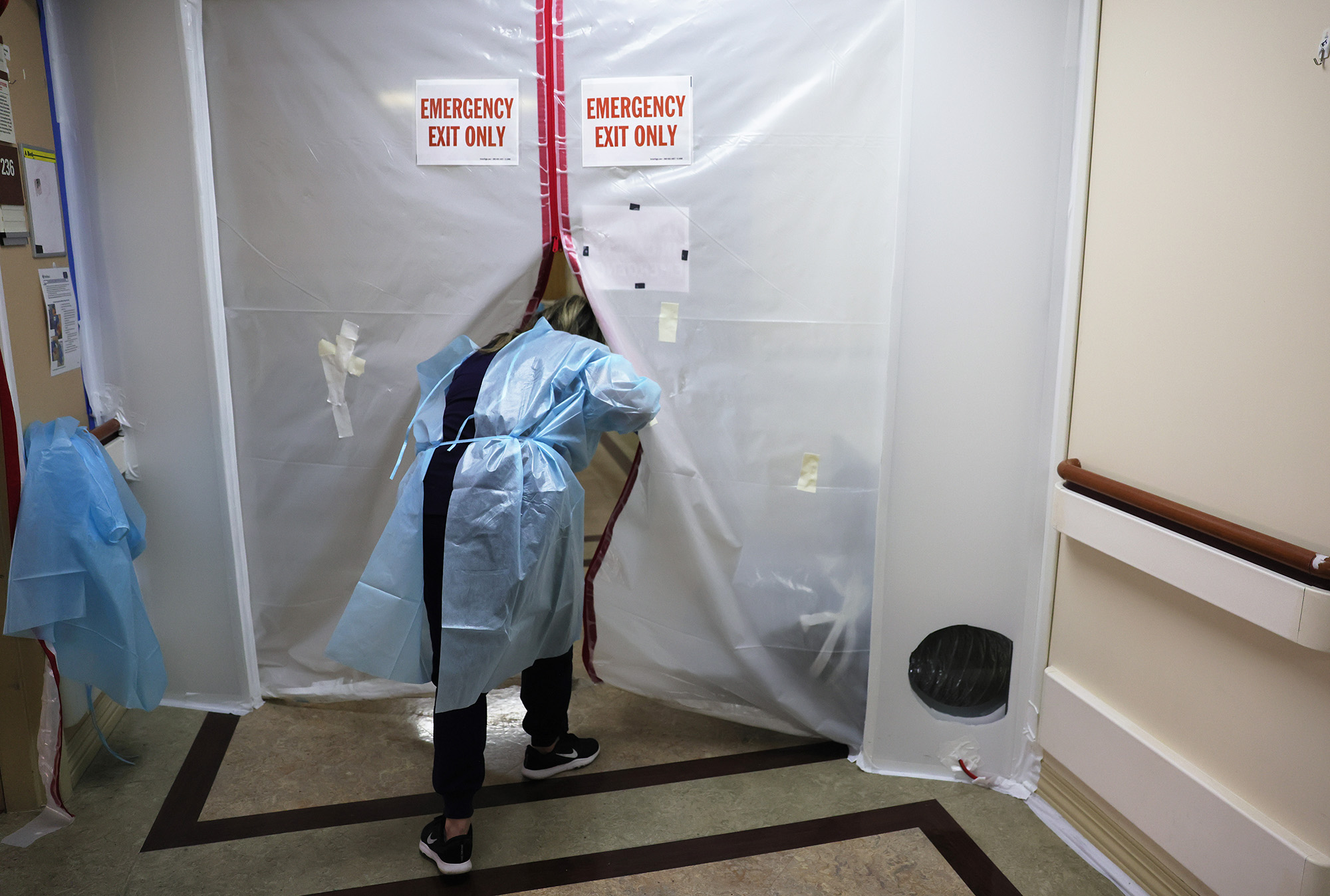 A clinician walks out of a Covid isolation area at Providence St. Mary Medical Center on December 23, in Apple Valley, California.