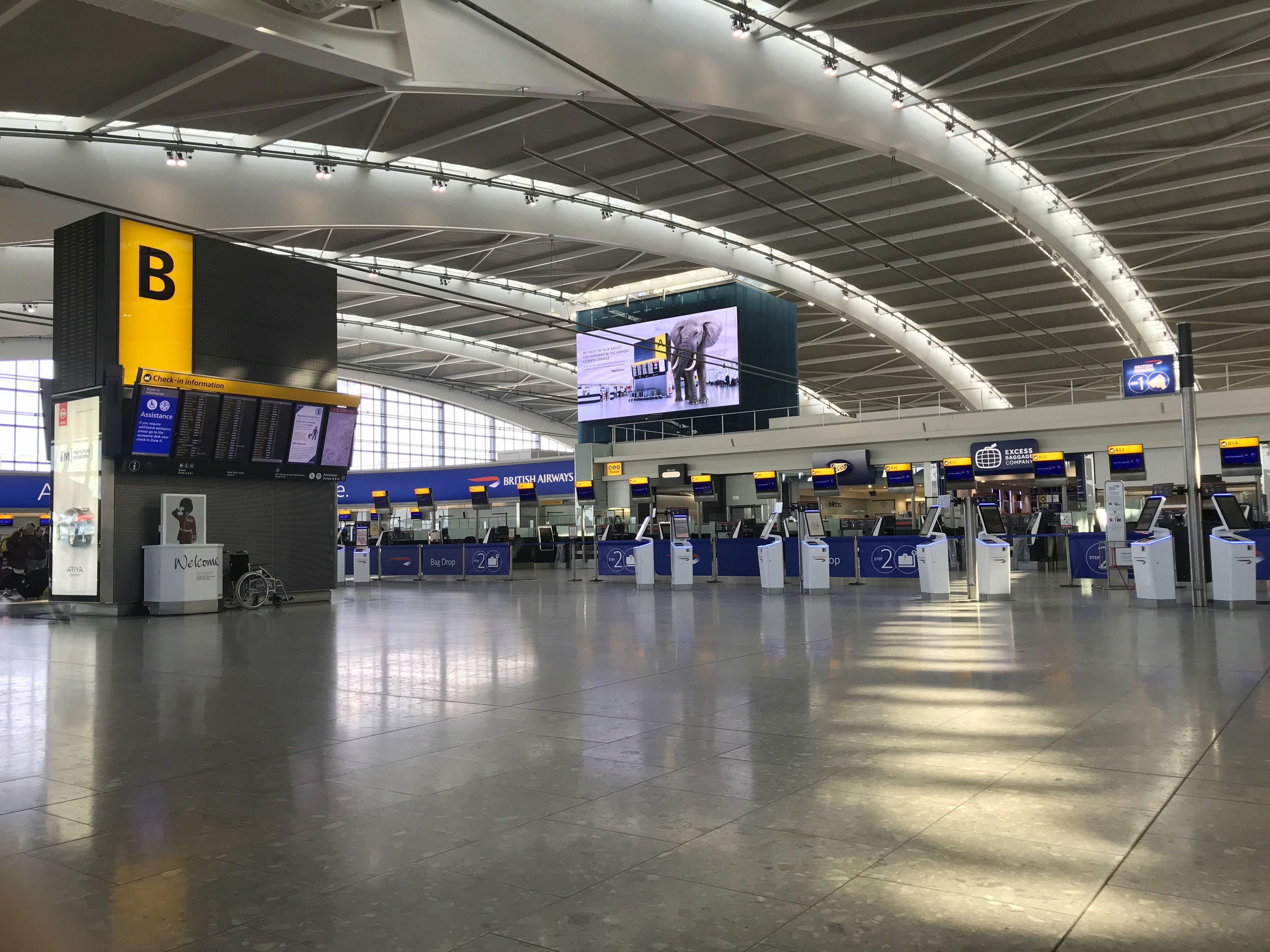 A view of the near empty departure area at London's Heathrow Airport's Terminal 5 departure, Thursday March 12, 2020.