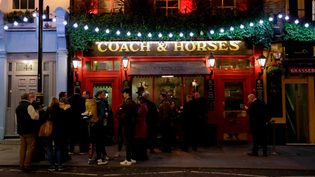Crowds still gather in London, here at a pub in Covent Garden, a popular tourist area.