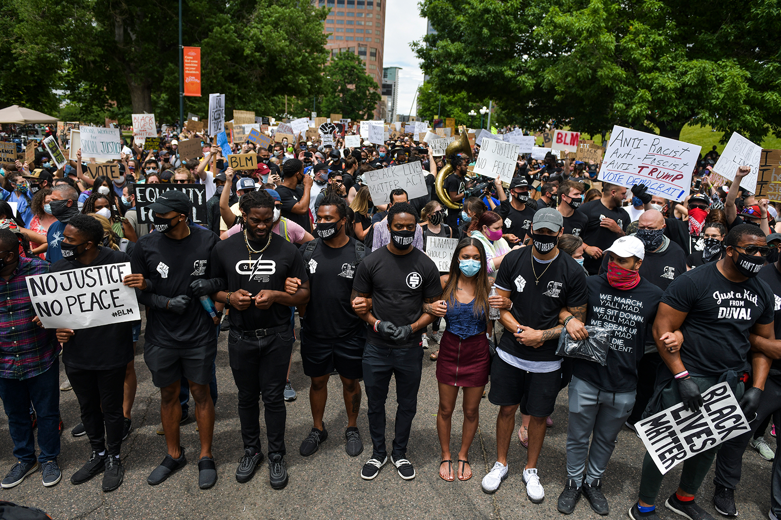 Denver Broncos players join people protesting on June 6, in Denver, Colorado.