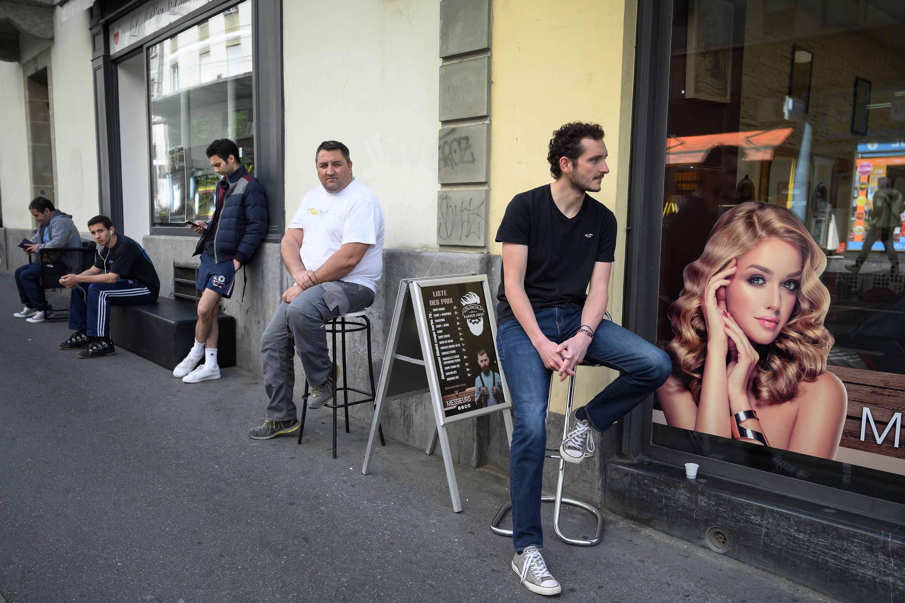 People queue outside a hair salon in Lausanne on April 27, after Switzerland began easing restrictions imposed to control the COVID-19 pandemic.