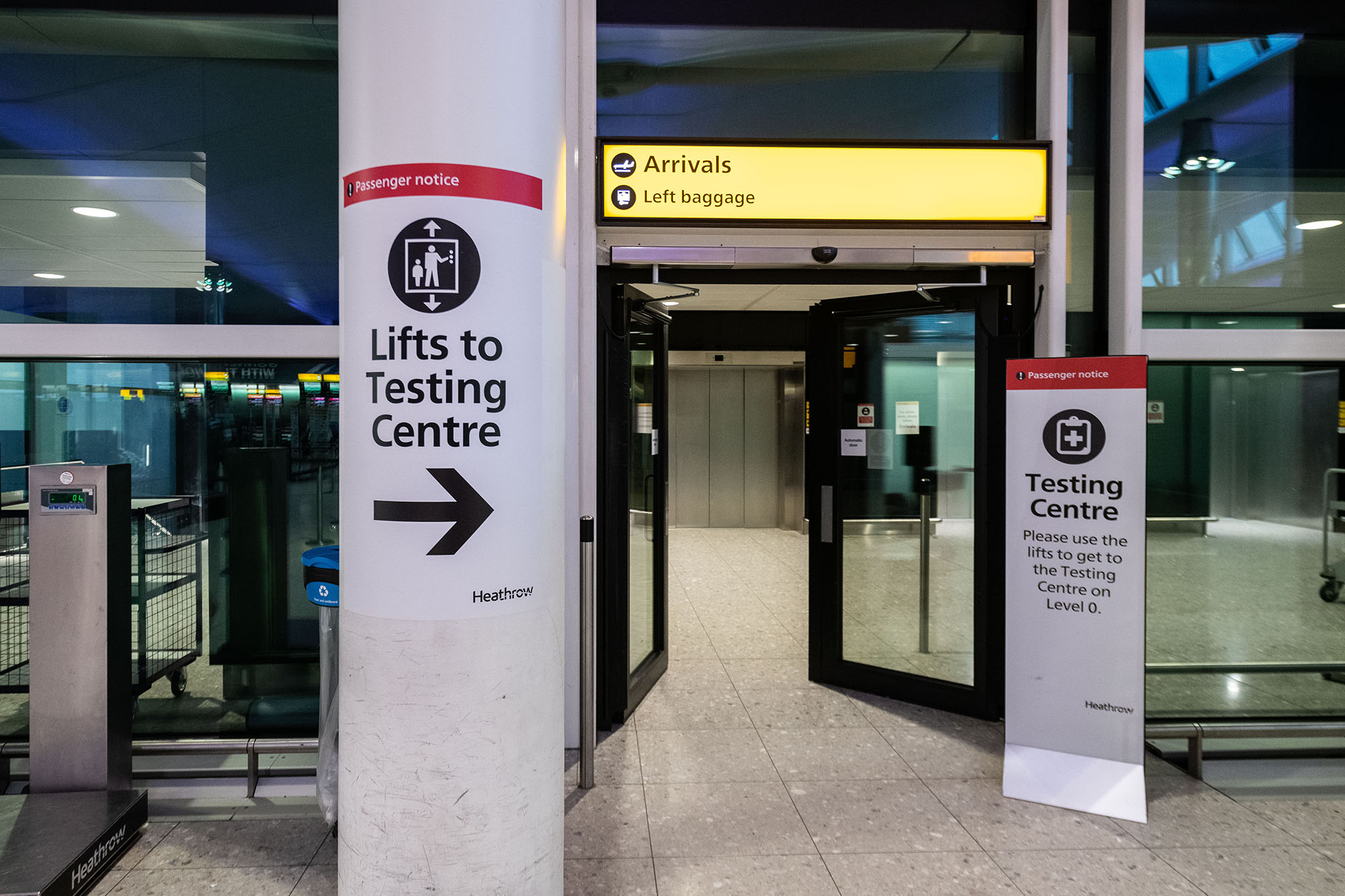A view of signage leading to one of the testing centers at Heathrow Airport on December 22, in London, England.