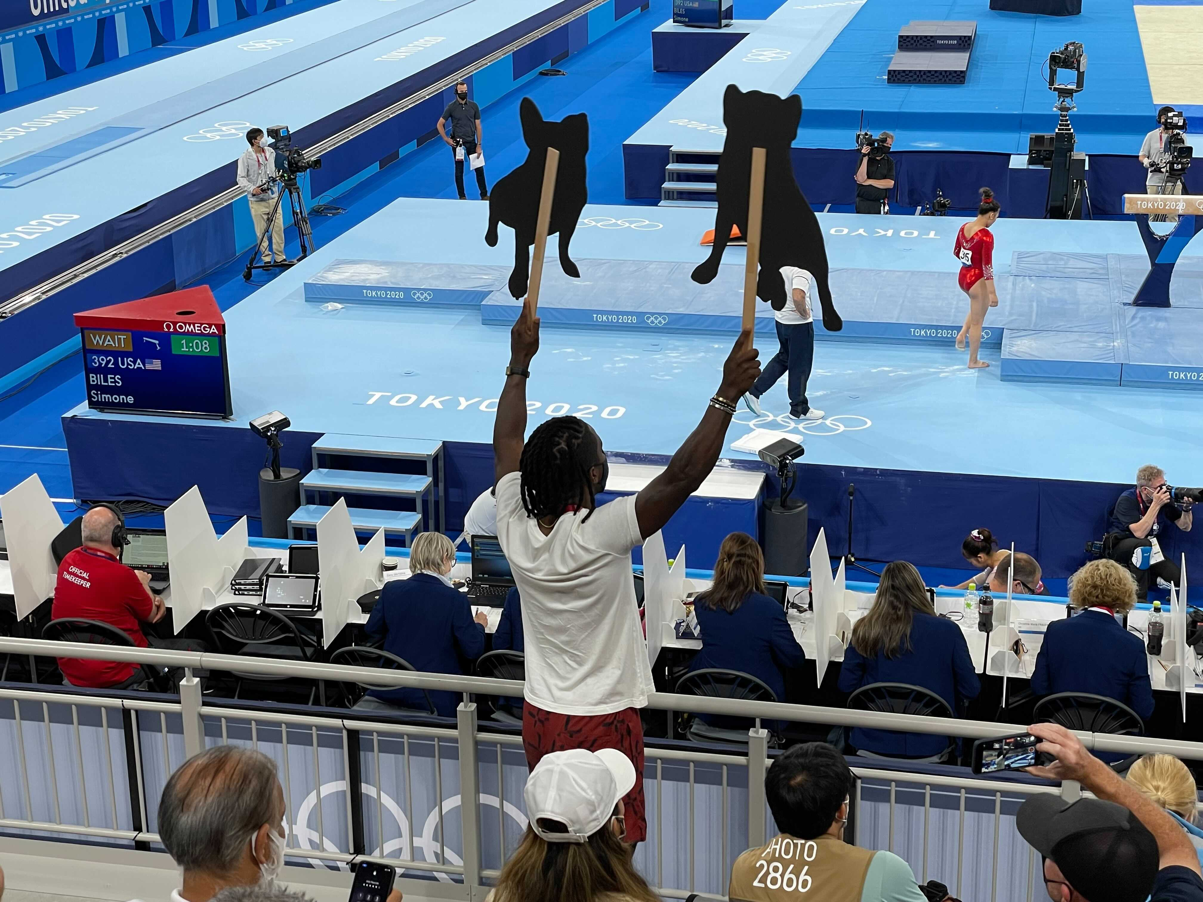 Evans waves the cutouts for Biles.