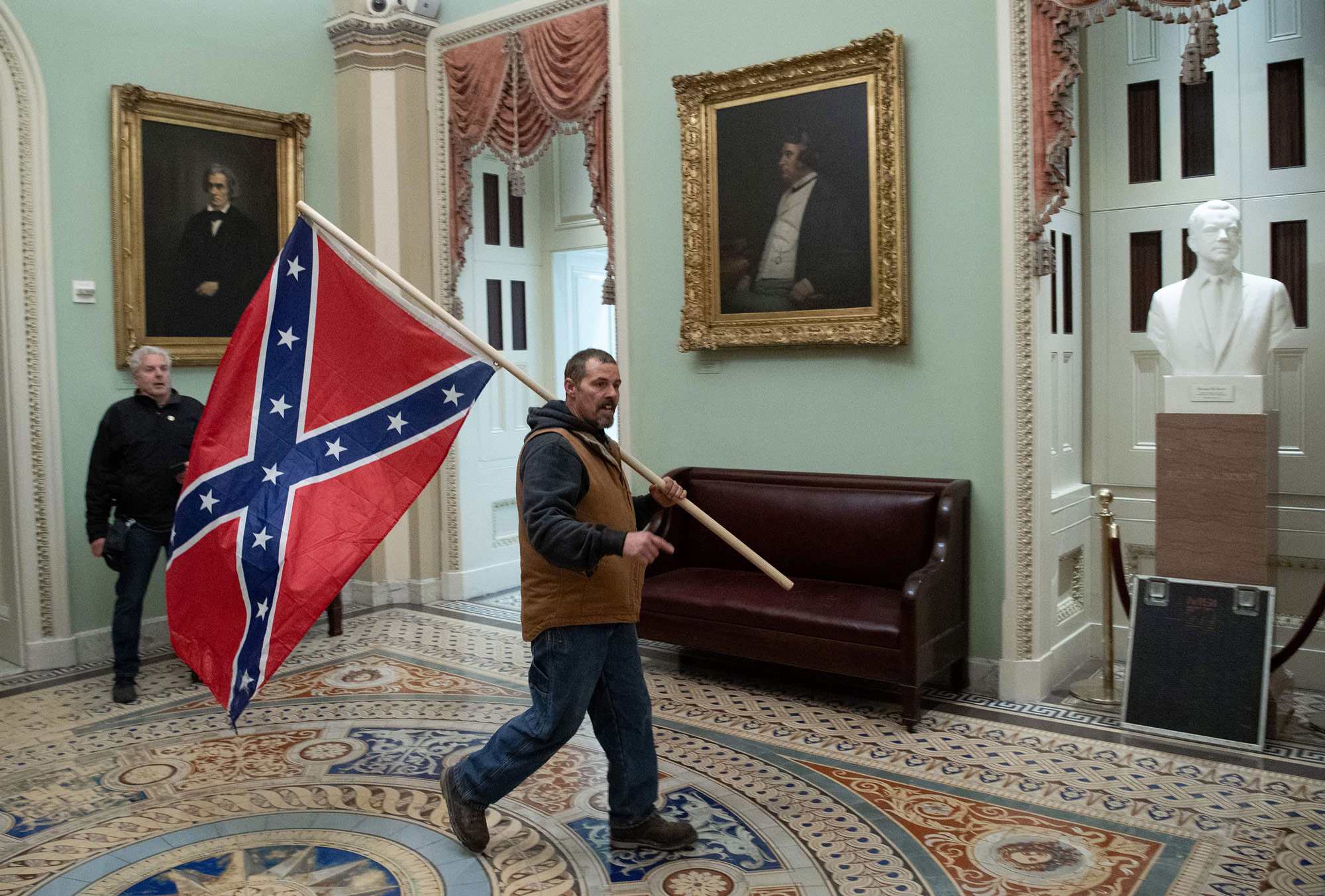 Kevin Seefried carries a confederate flag in the US Capitol Rotunda on January 6 in Washington, DC.