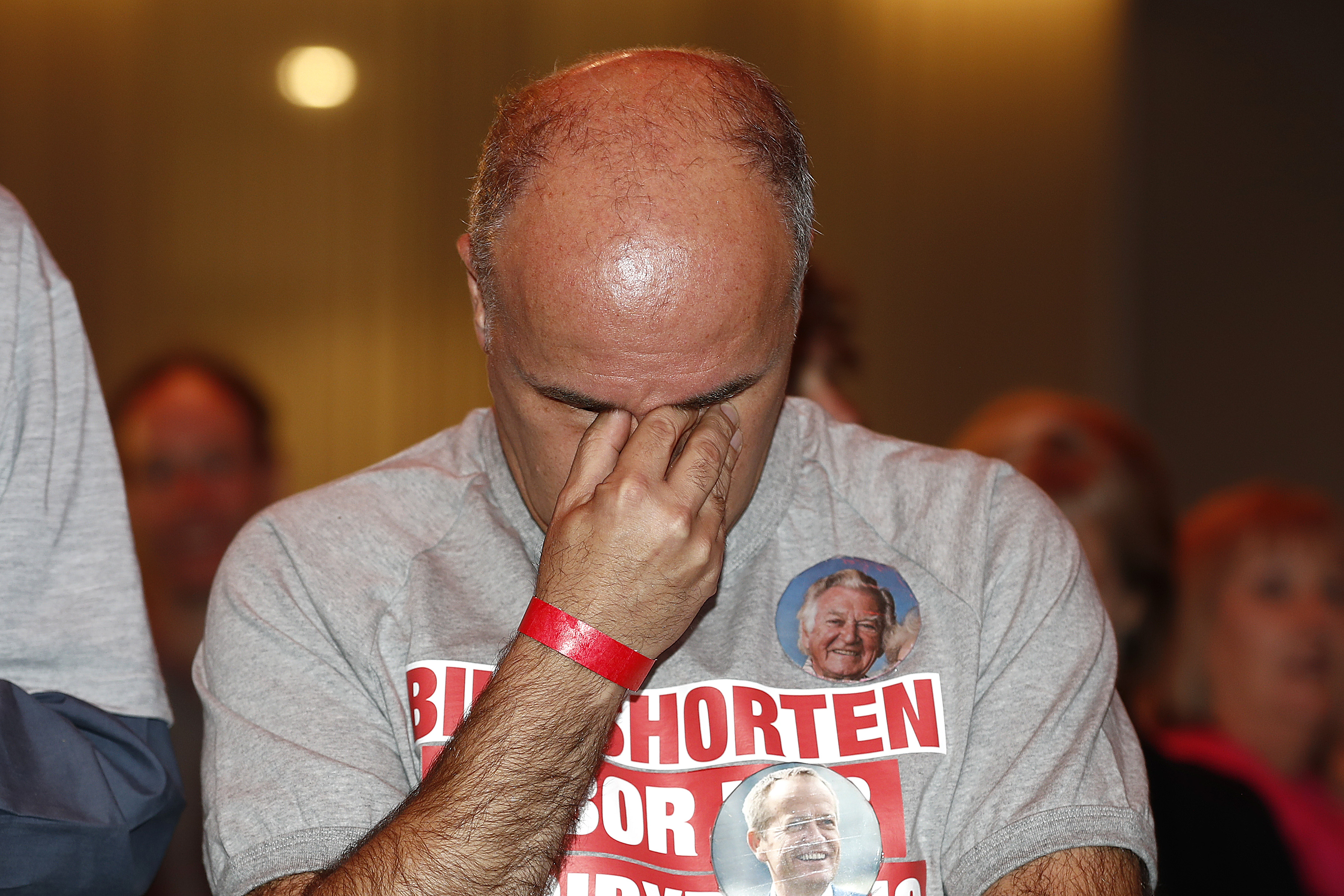 A Labor supporter reacts at a function in Melbourne on Saturday.