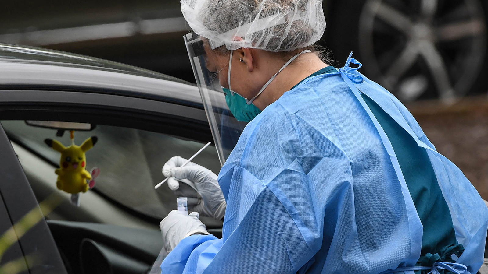 AnMed phlebotomists test people in their cars during a free COVID-19 testing at the Civic Center in Anderson South Carolina on June 18.