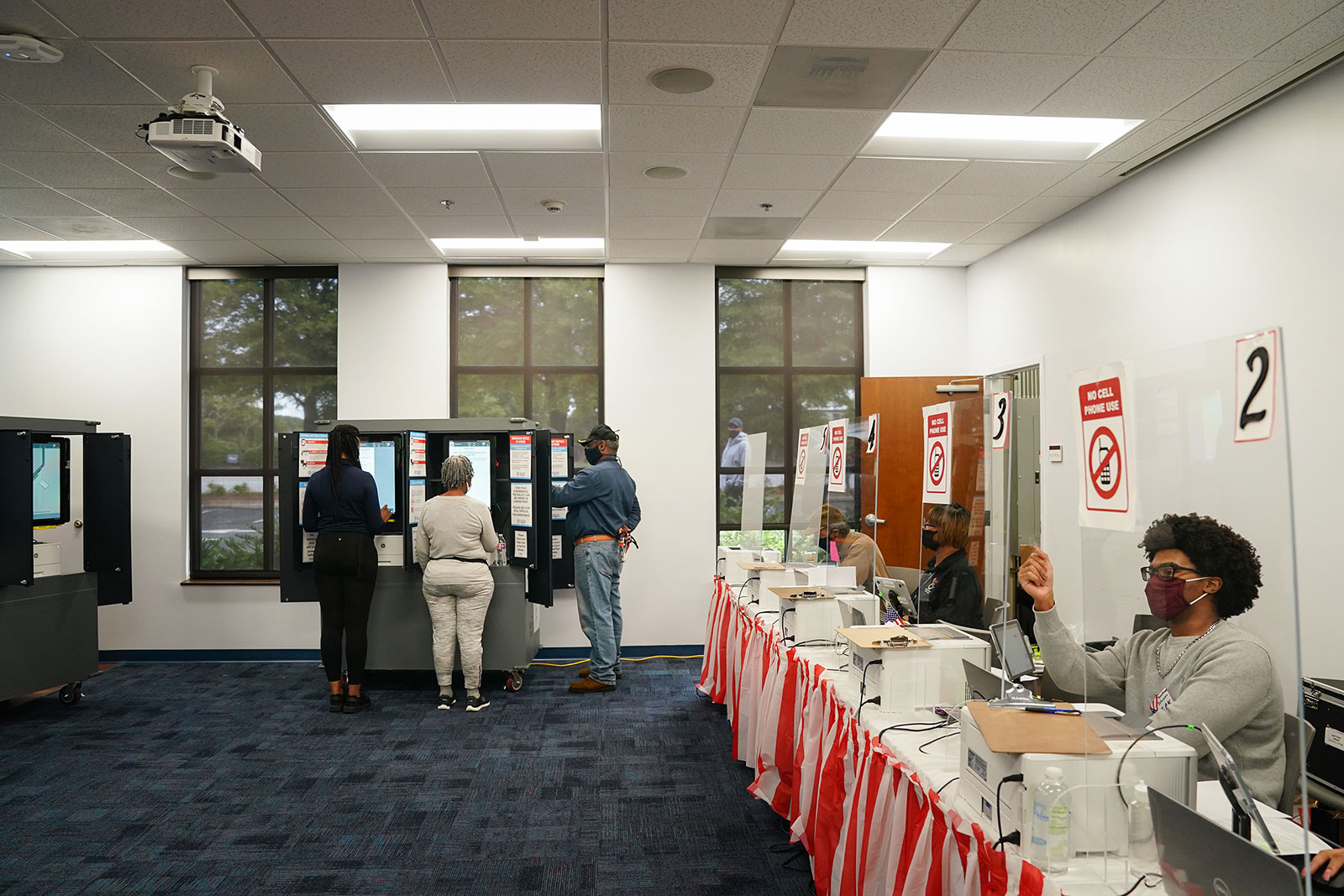 People cast their ballots during early voting in Atlanta, Georgia, on October 12.