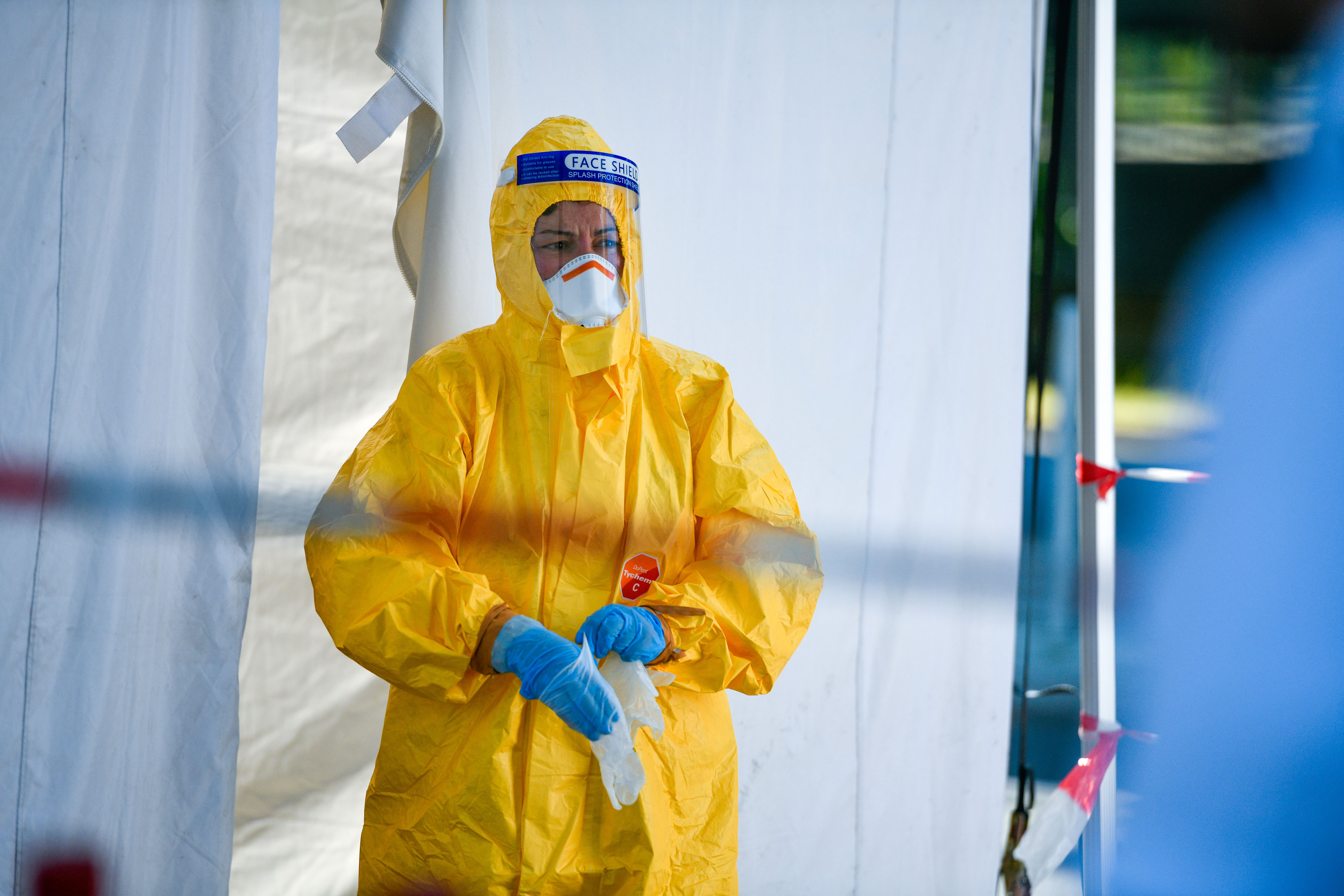 A worker at a Covid-19 testing station at Cologne Bonn Airport in Germany on August 8.