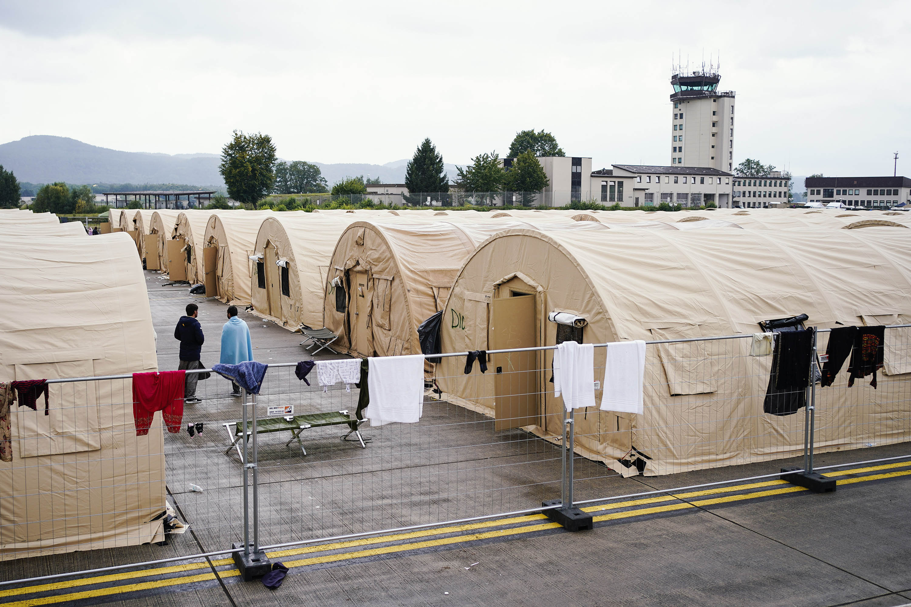 People evacuated from Afghanistan are seen between tents at Ramstein Air Base in Germany on August 30.