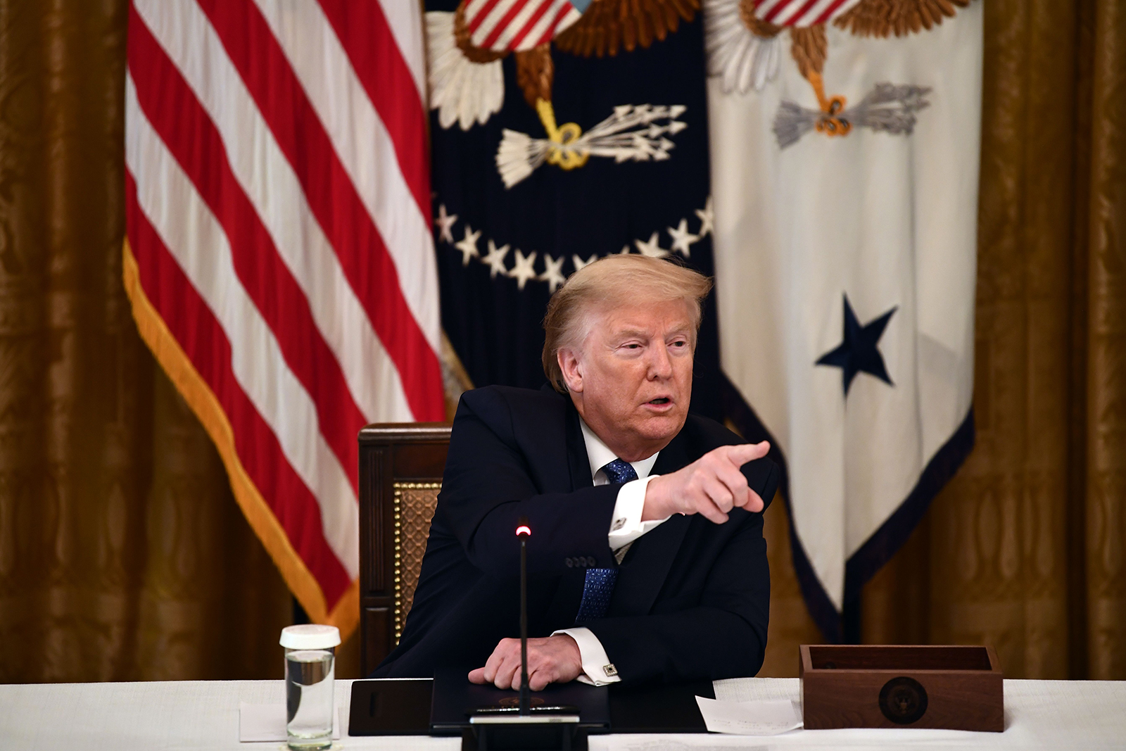 President Donald Trump speaks during a meeting with his cabinet on Tuesday, May 19, in Washington.