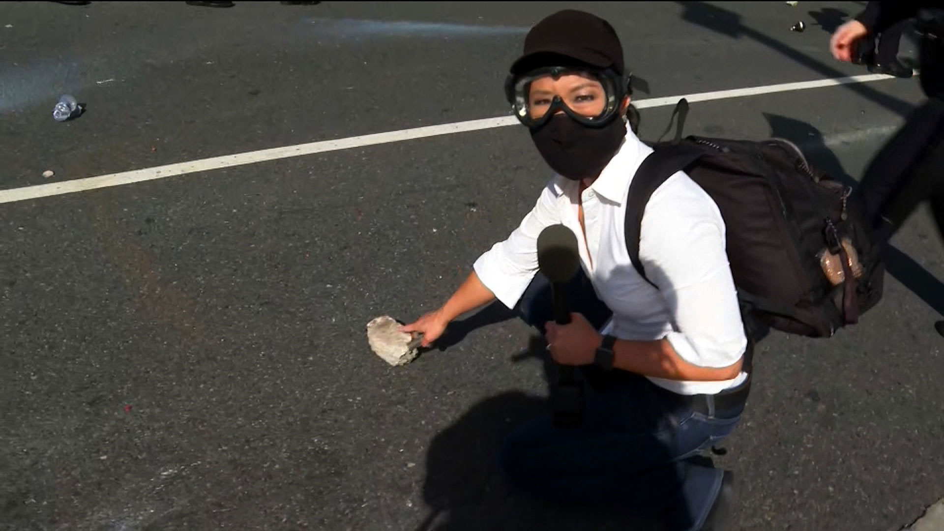 CNN's Kyung Lah points to a piece of concrete being thrown at police in Santa Monica on May 31.