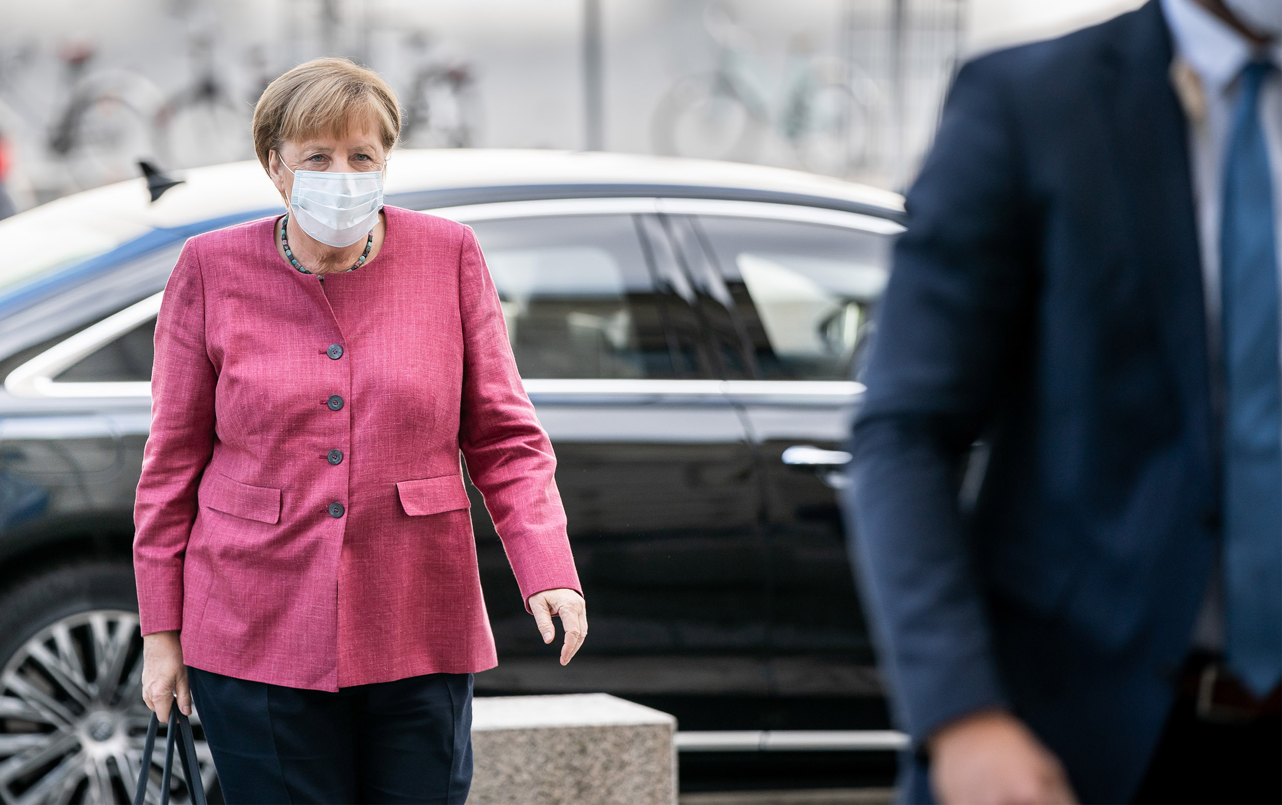 German Chancellor Angela Merkel arrives at the Bundestag for the meeting of the CDU/CSU parliamentary group in Berlin, on September 28.