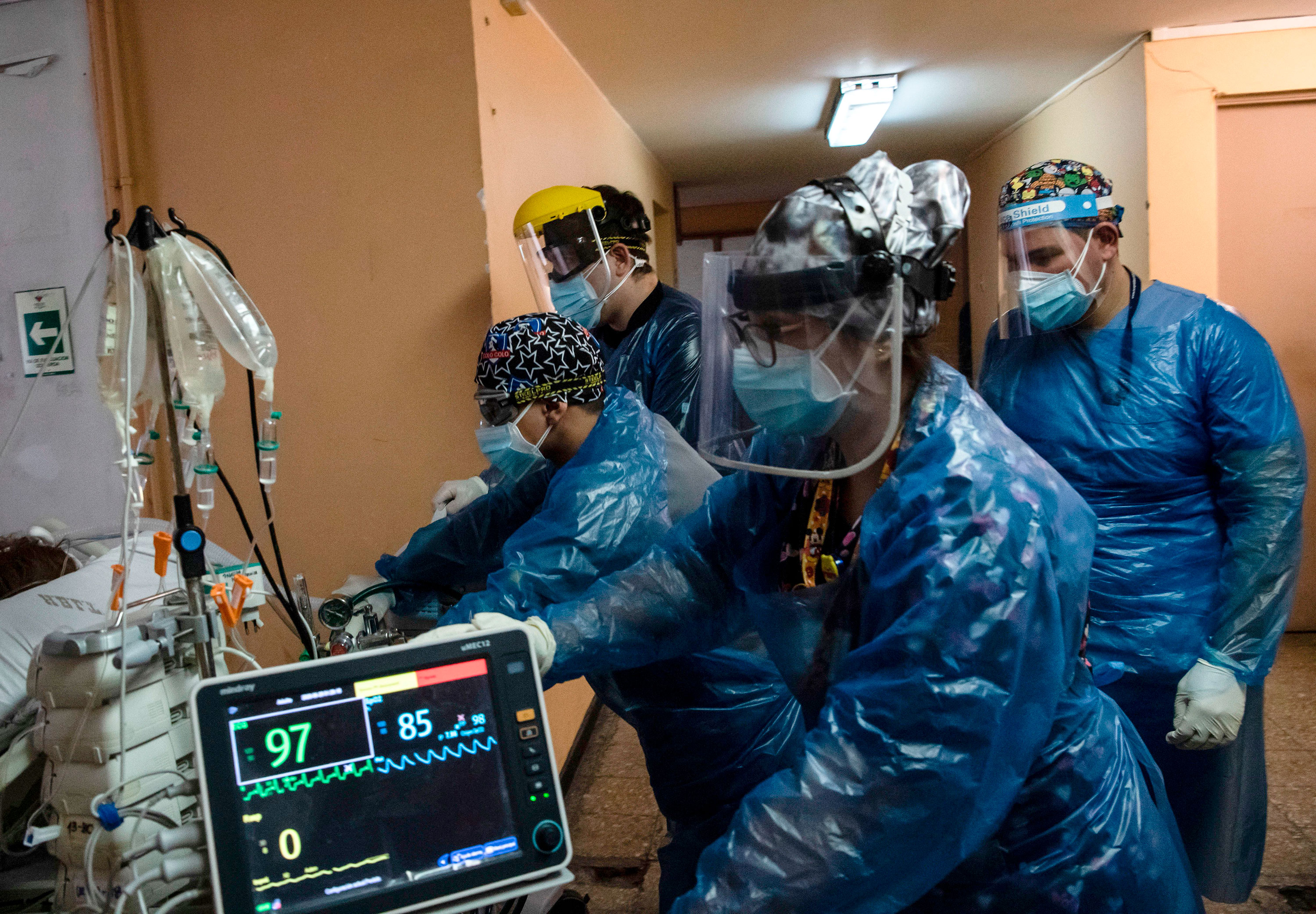 Nurses transfer a Covid-19 patient to the Critical Patients Unit at Barros Luco Hospital on June 24 in Santiago, Chile.