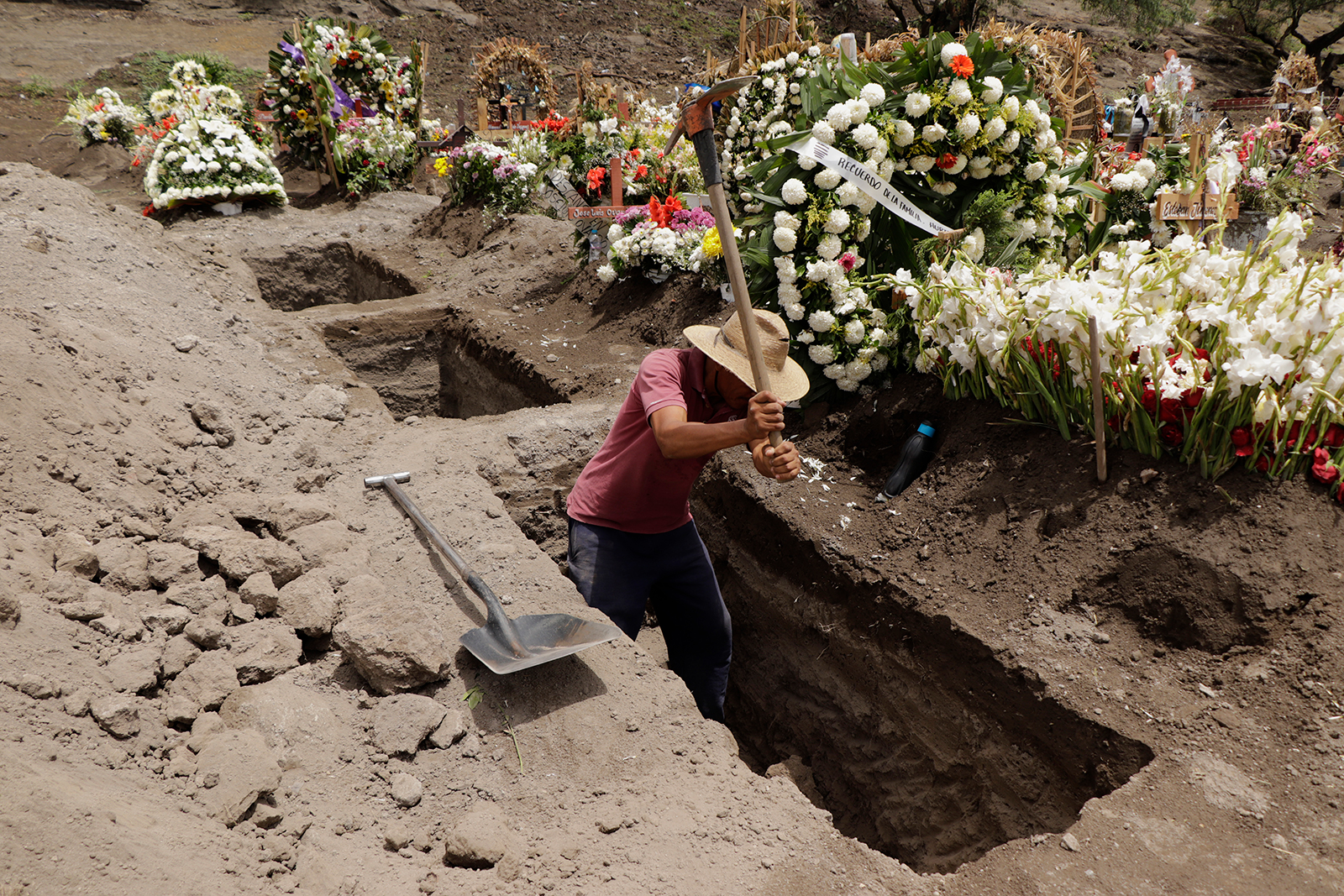A man digs graves in the Xico-Chalco Civil Pantheon, State of Mexico, on June 26.