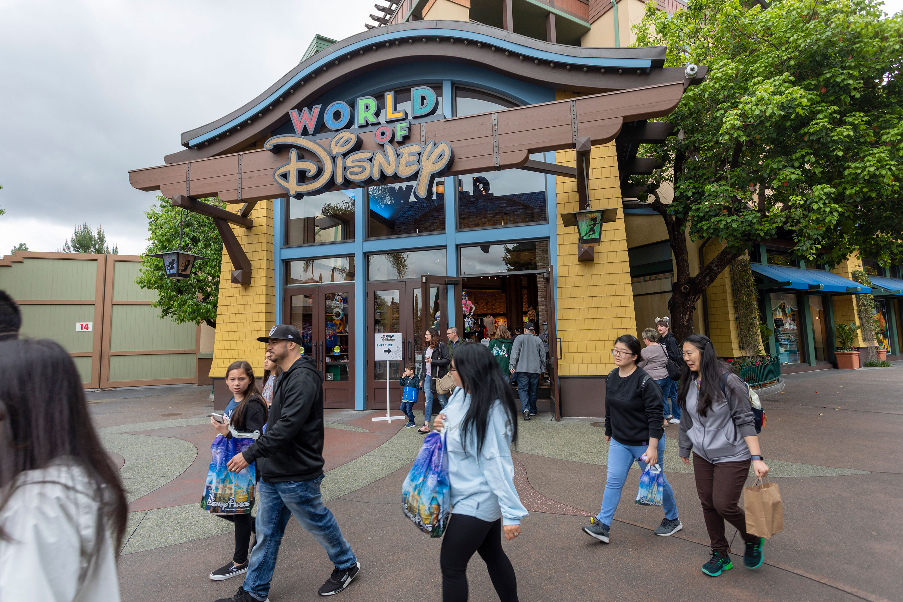 People walk near the World of Disney store in the Downtown Disney District shopping mall in Anaheim, California, on March 14.