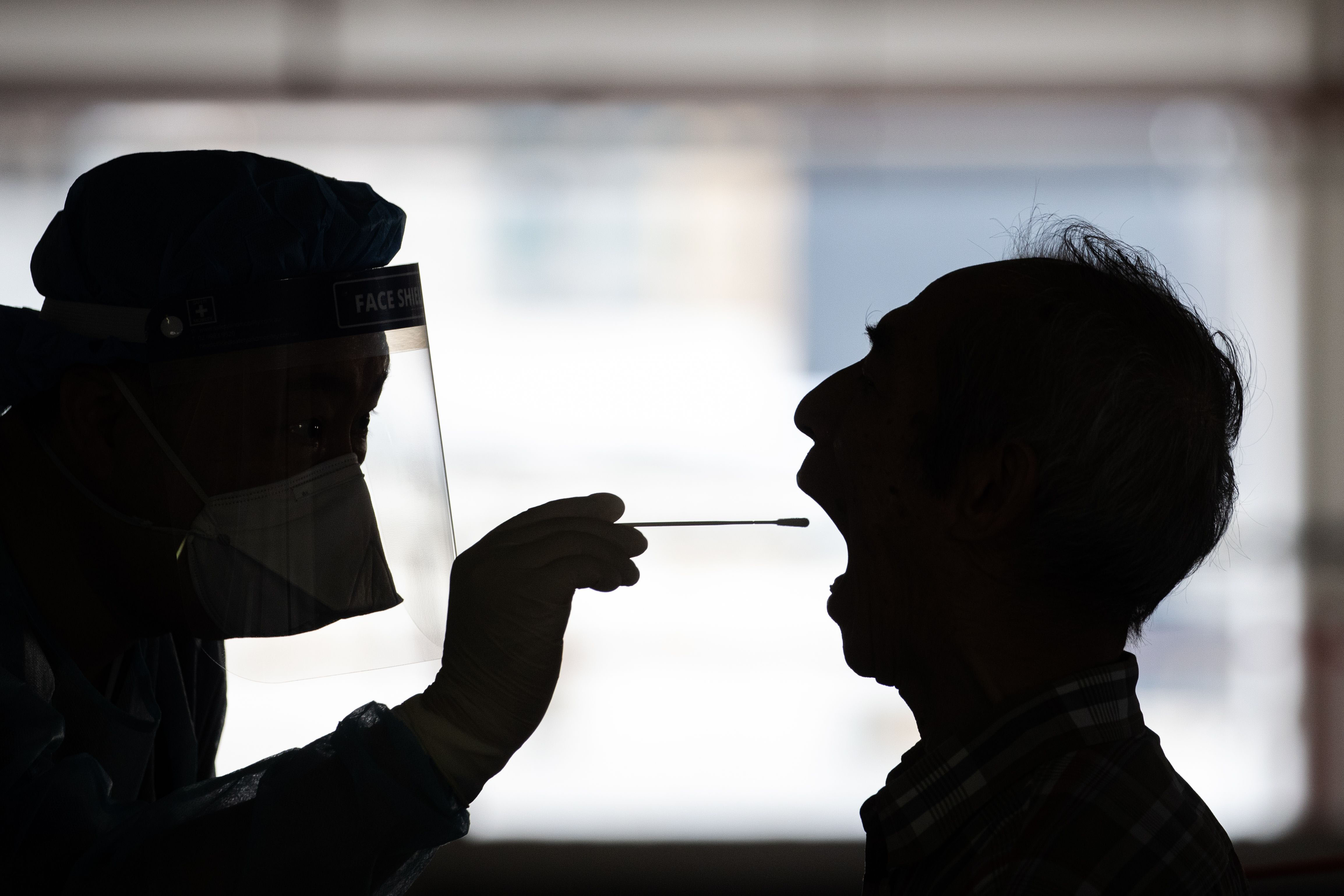 A person undergoes a swab test on July 23 at a makeshift Covid-19 testing lab in Hong Kong.