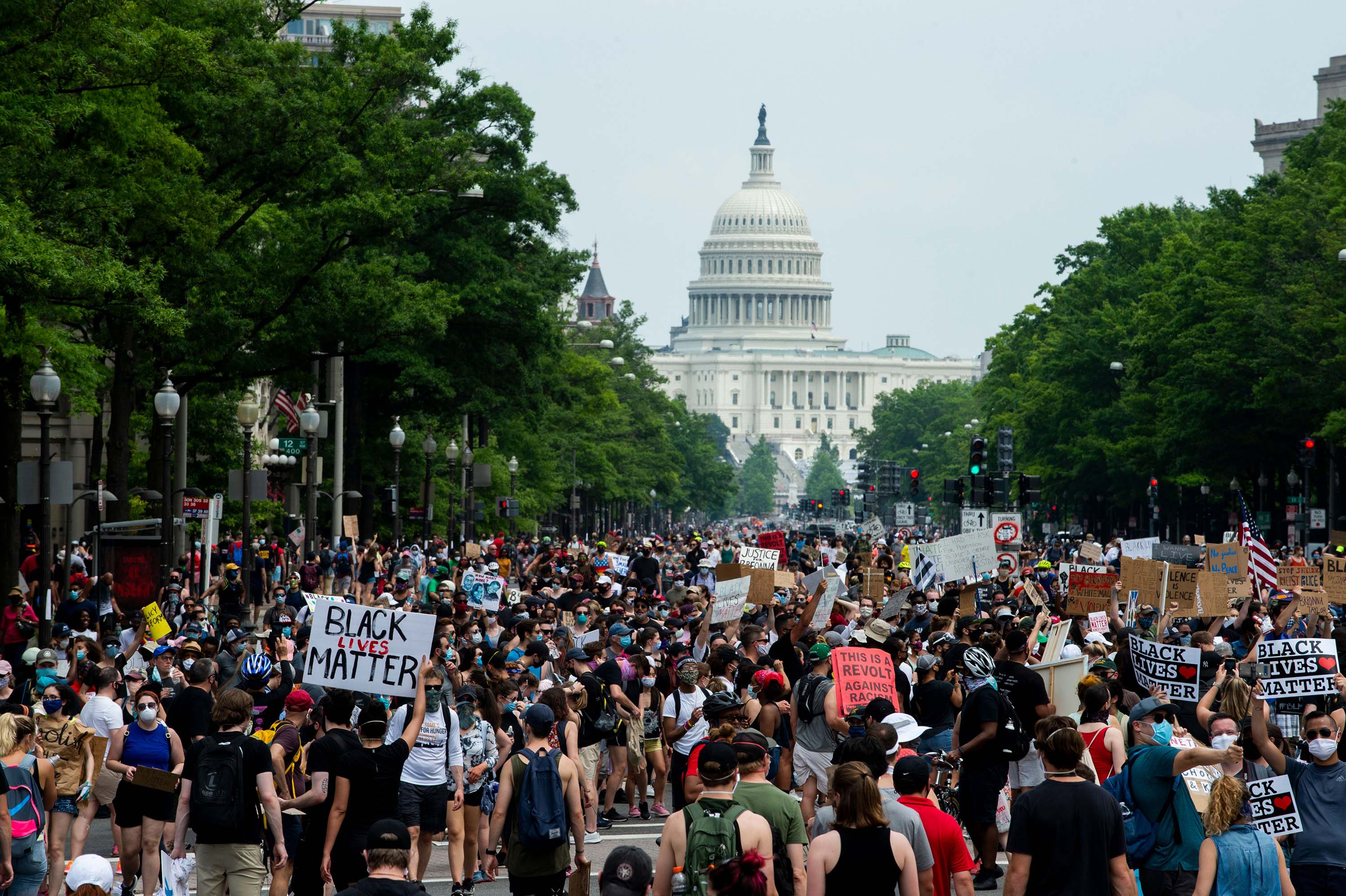 A crowd of protesters walk from the Capitol building to the White House during a protest against police brutality and racism, on June 6, in Washington, DC.