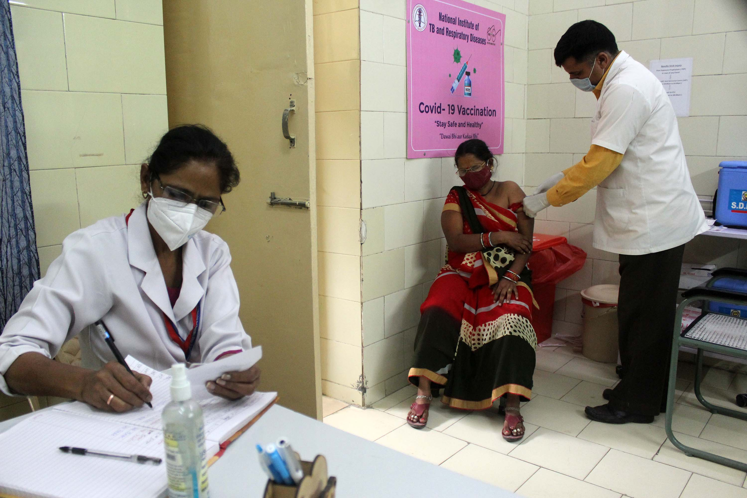 A woman receives a dose of the COVISHIELD coronavirus vaccine, manufactured by India's Serum Institute, at a government hospital in New Delhi, on April 9.
